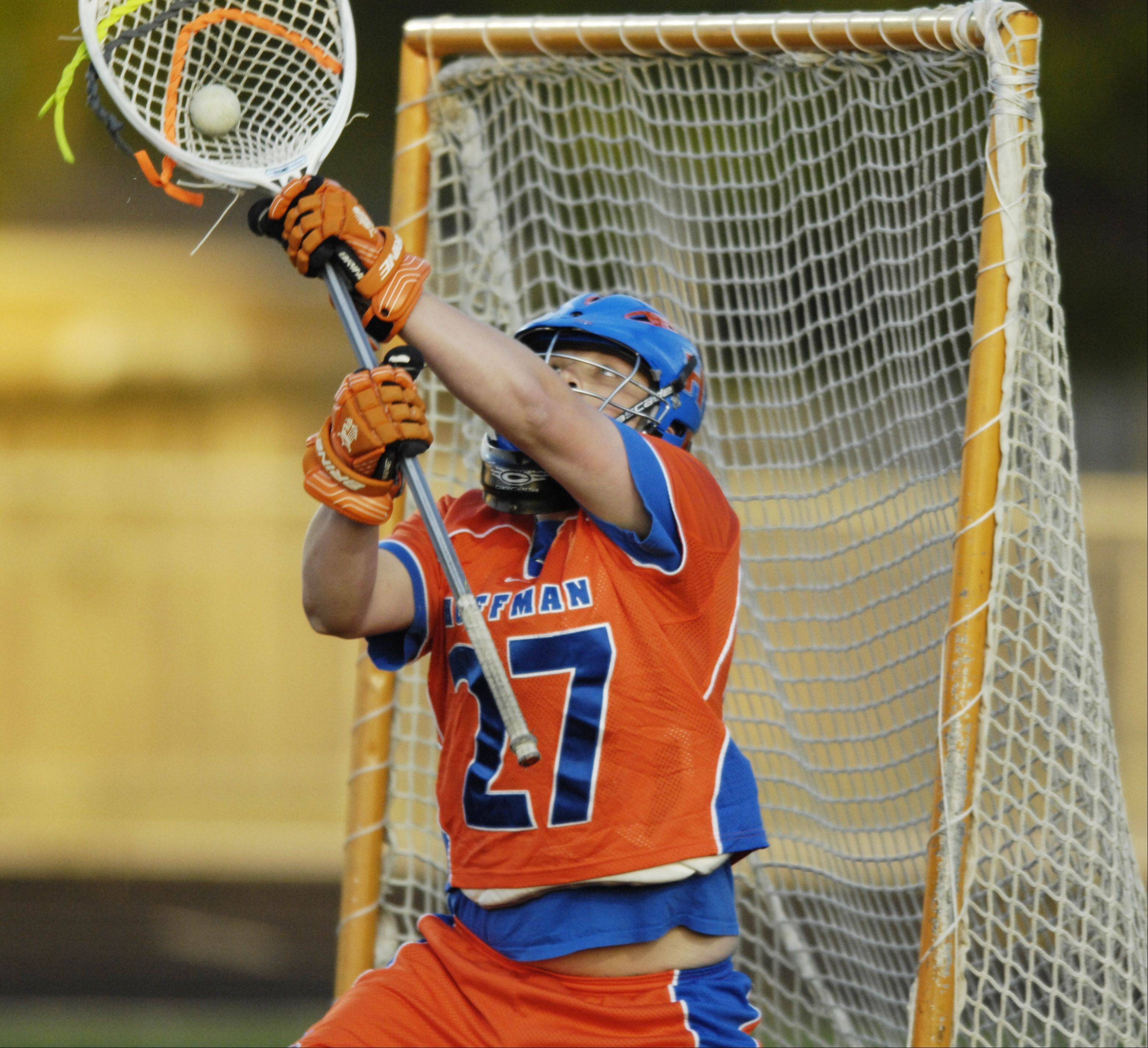 Hoffman Estates goalie Doug Johnson makes a save during last Tuesday's match at Fremd.