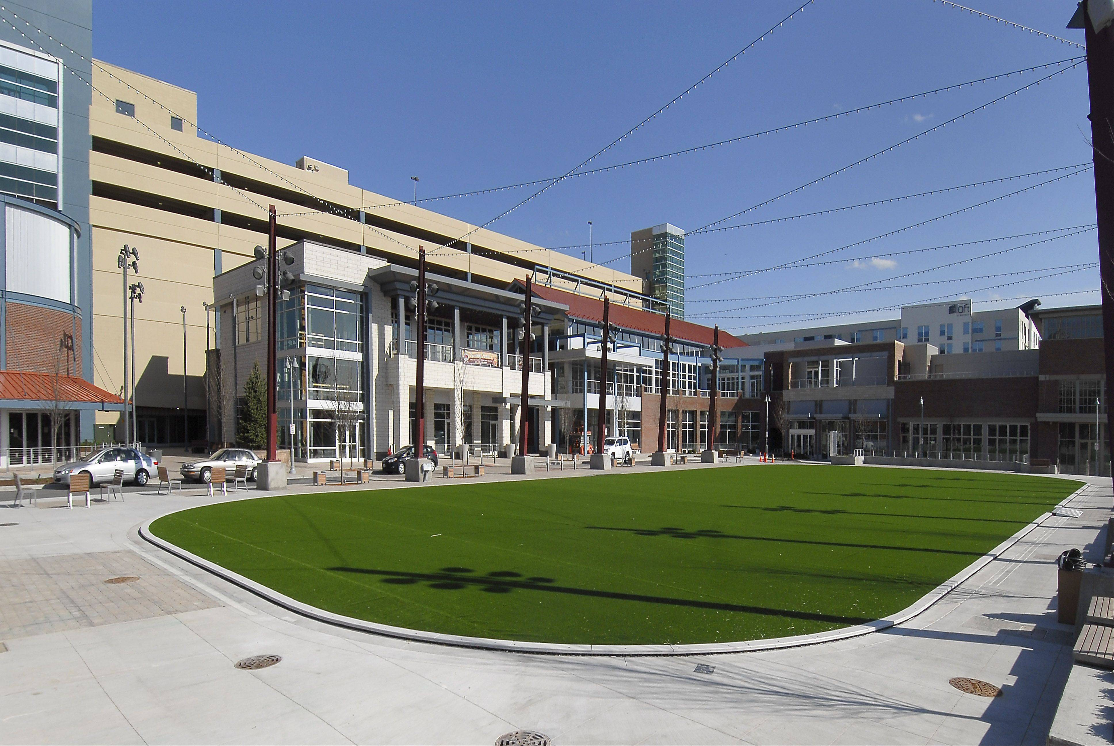 The Park at Rosemont entertainment district features an artificial turf lawn that doubles as an ice rink in winter. Rosemont officials announced Tuesday they have reached a deal with MB Financial Bank to sell naming rights to the district for $3 million.