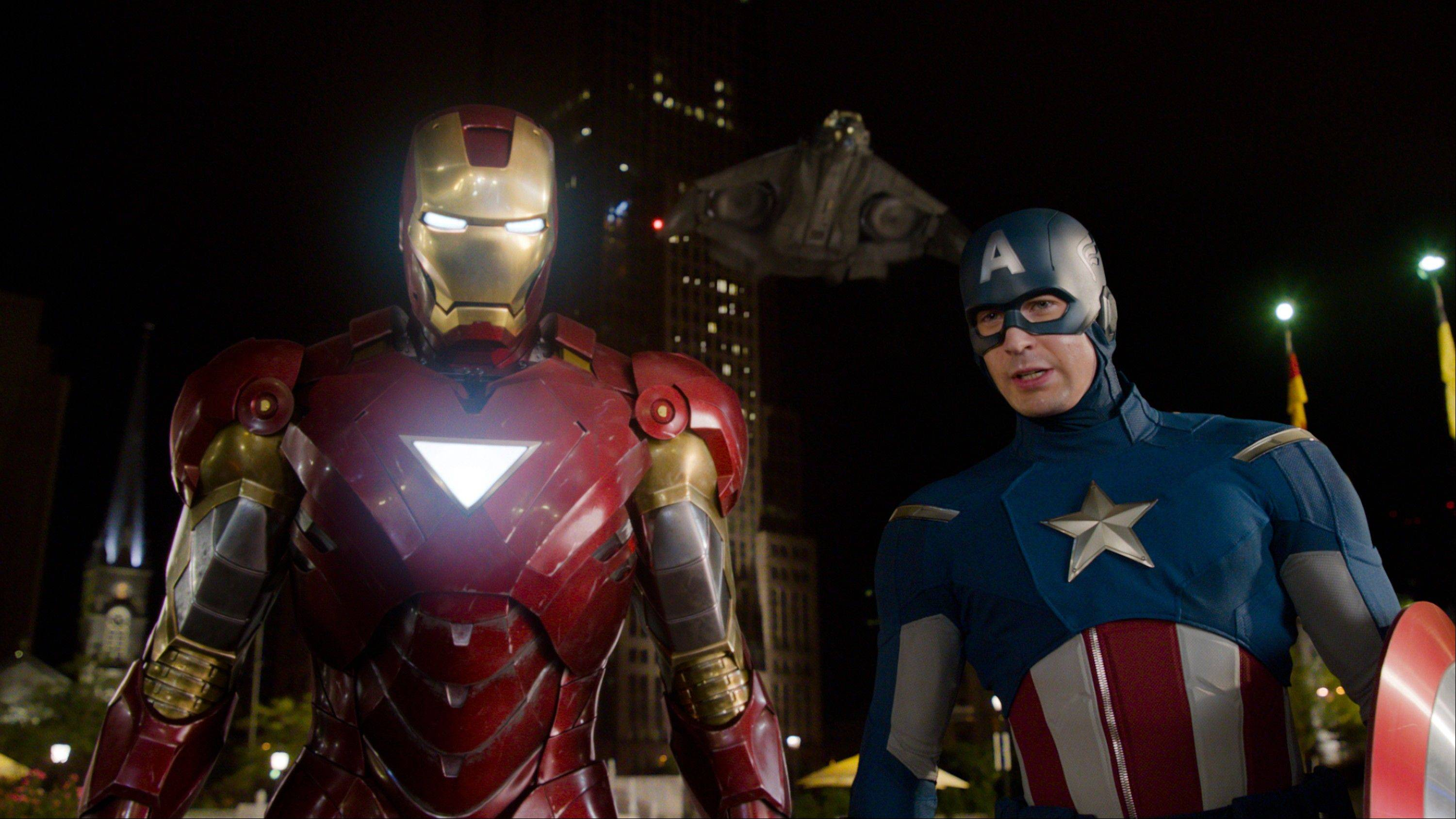 "Iron Man (Robert Downey) reluctantly joins forces with Captain America (Chris Evans) to save earth in ""The Avengers."""