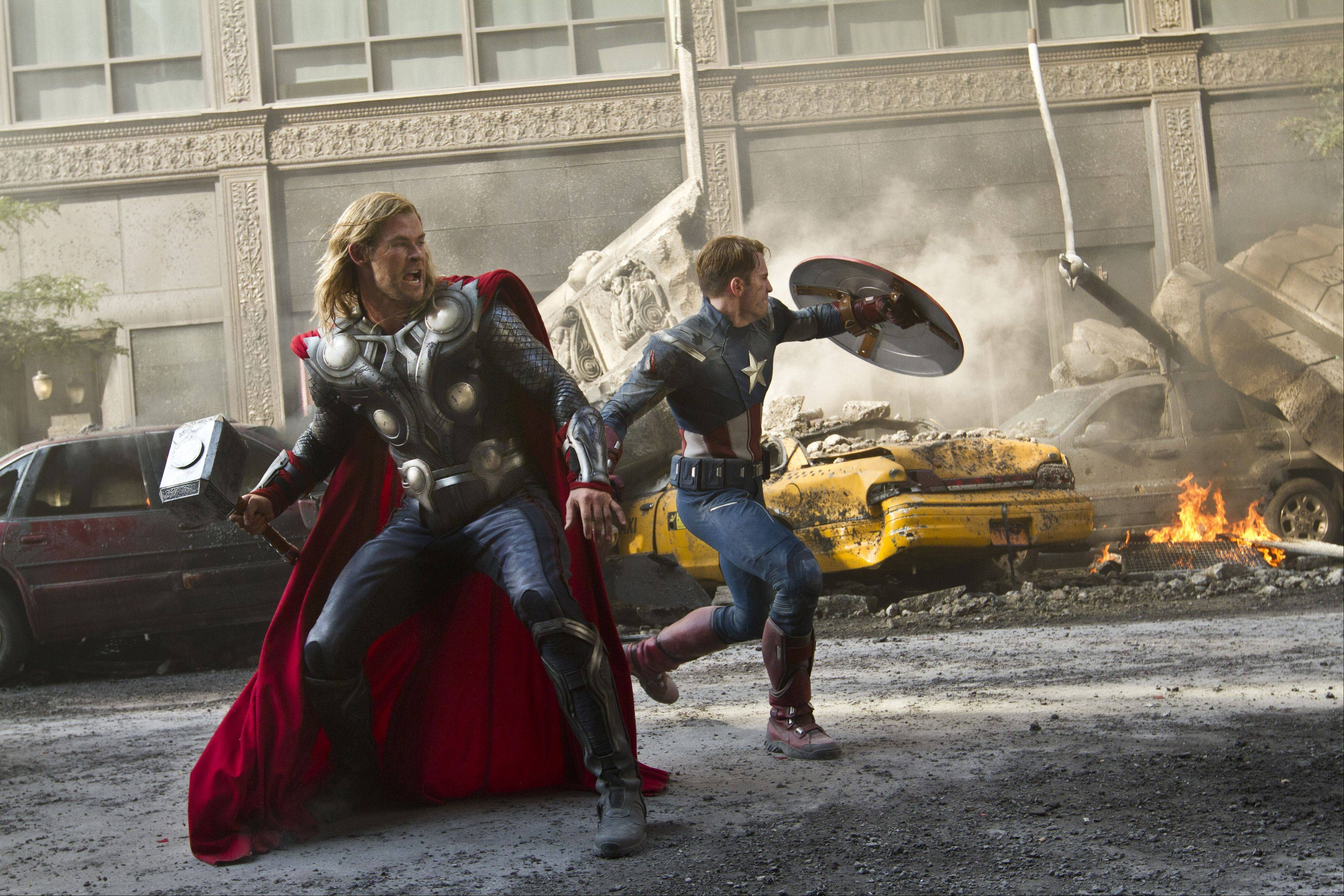 "Thor (Chris Hemsworth) and Captain America (Chris Evans) repel an alien attack in ""Marvel's The Avengers."""