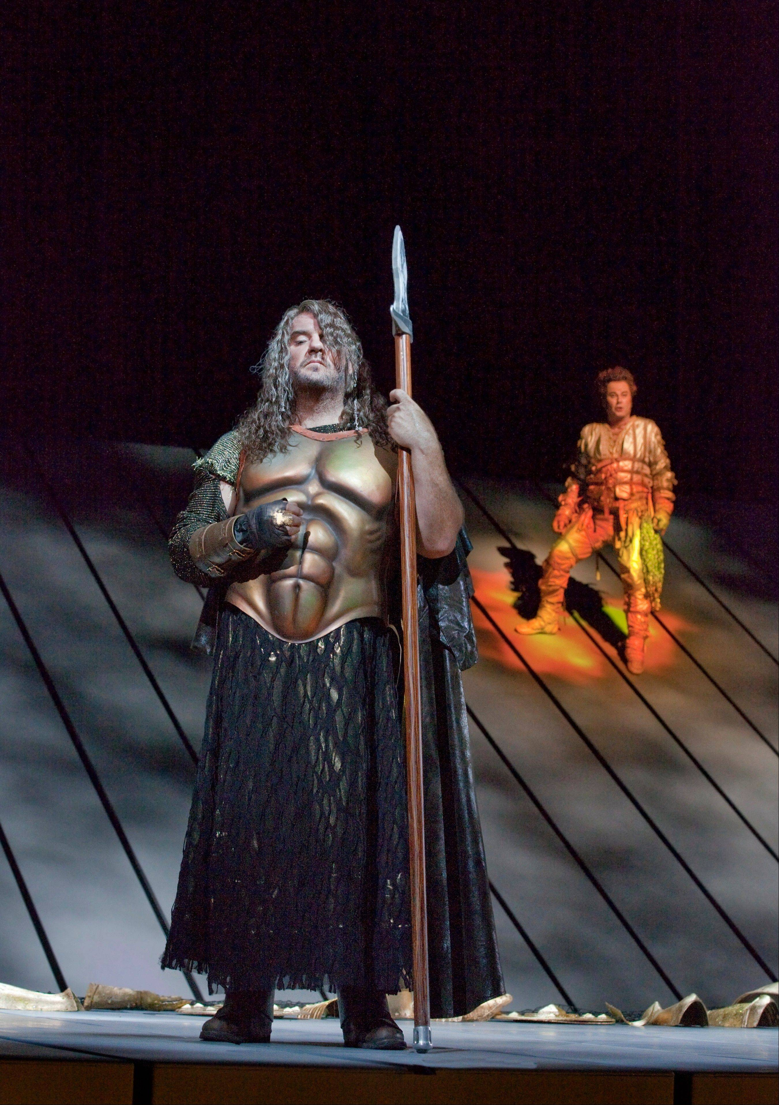 "Wotan (Bryn Terfel) gets dodgy advice from the fire god Loge (Richard Croft) in Wagner's ""Das Rheingold,"" the first of four operas staged in Robert Lepage's production of the monumental ""Der Ring des Nibelungen"" for the Metropolitan Opera. The four operas are rescreened in select movie theaters in May."