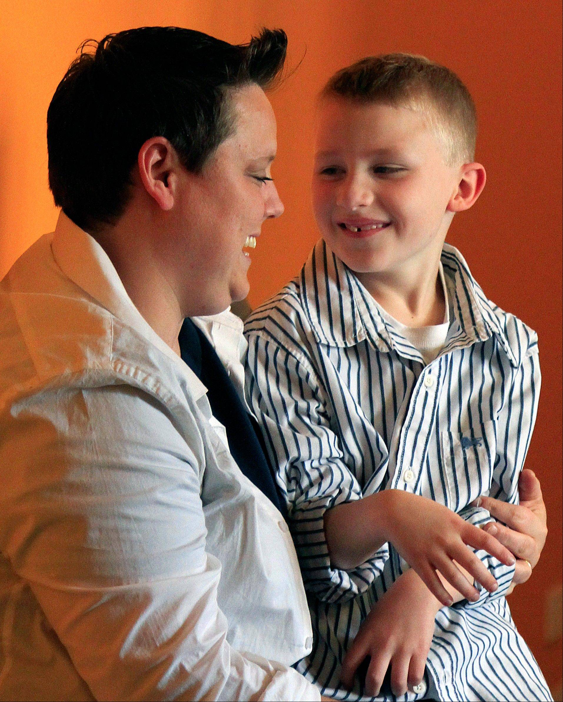 This Wednesday, April 25, 2012 photo shows Jennifer Tyrrell and her son Cruz Burns, 7, during a visit to New York. Tyrrell traveled to New York from her home in Bridgeport, Ohio, to build momentum for a petition to overturn what she says are Ohio Boy Scout's anti-gay policies, after she was removed as den leader for her son's Cub Scout troop.