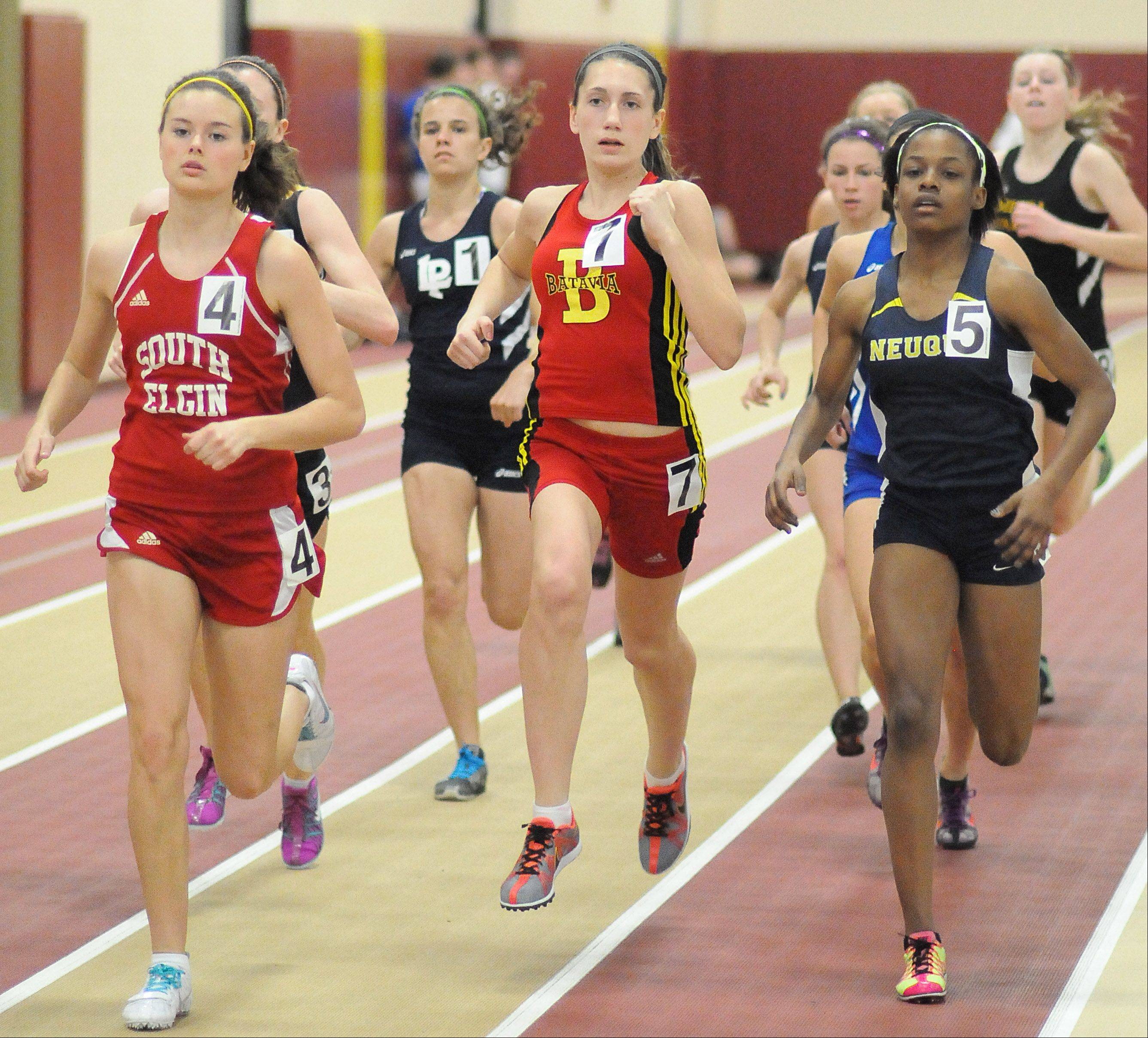 South Elgin's Jordan Tuin, Batavia's Alicia Grant and Neuqua Valley's Maya Neal in the third heat of the 800 meter run at the Upstate Eight Conference in Batavia on Saturday, March 17.