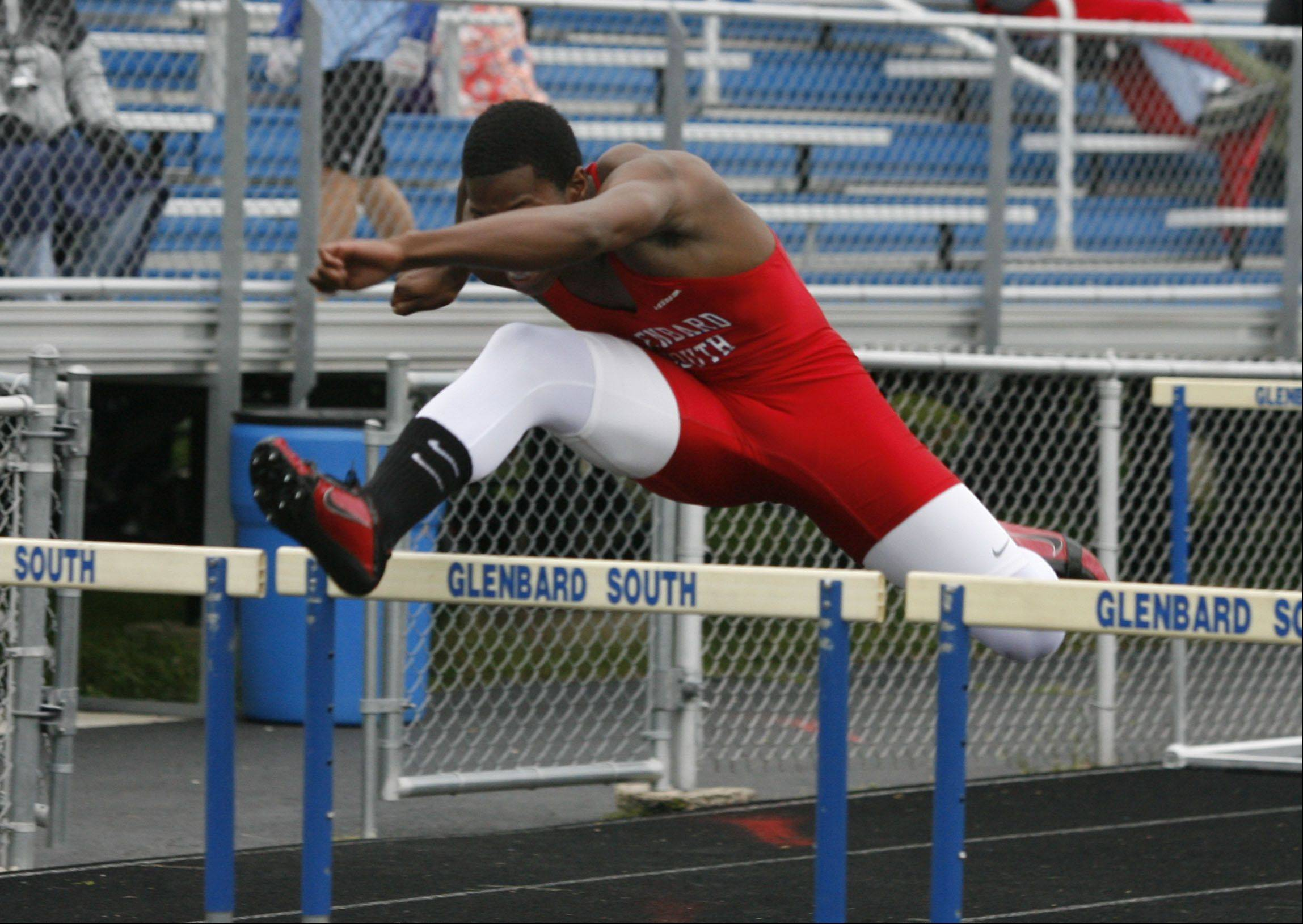 Glenbard South's Elven Walker wins the 110 Meter Hurdles, during the 11th annual Raider Track & Field Invitational at Glenbard South.