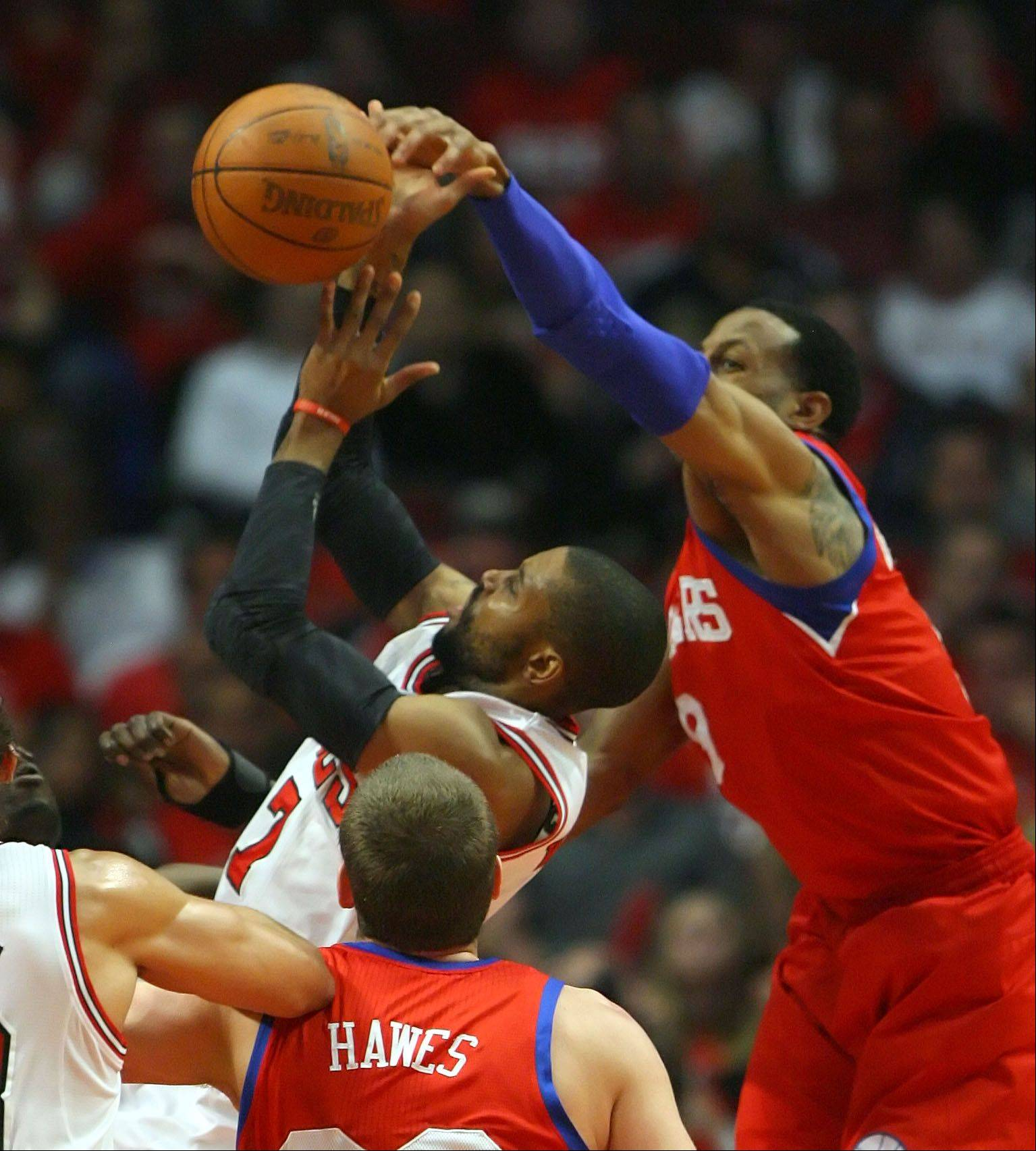 Chicago Bulls' C.J. Watson is blocked by Philadelphia 76ers' Andre Iguodala.