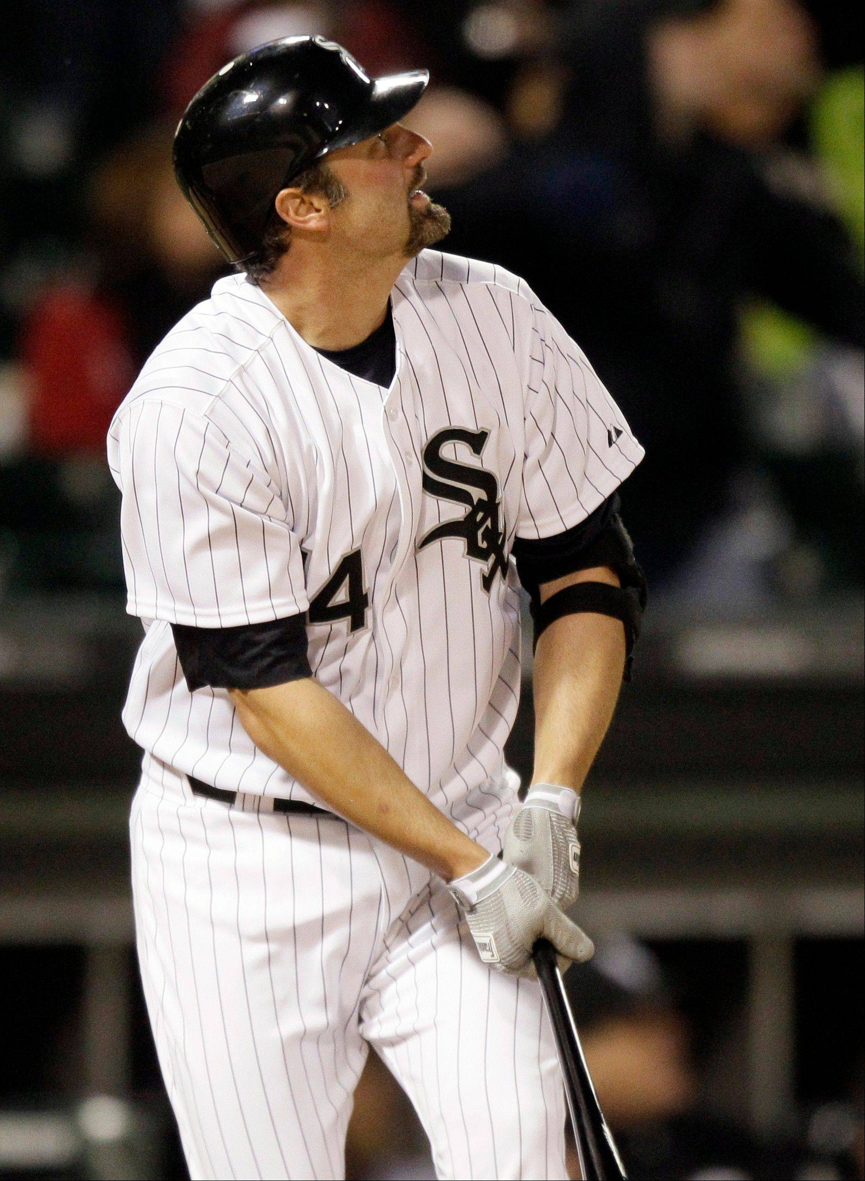 Paul Konerko watches his solo home run against the Boston Red Sox during the fifth inning of a baseball game in Chicago, Friday, April 27, 2012.