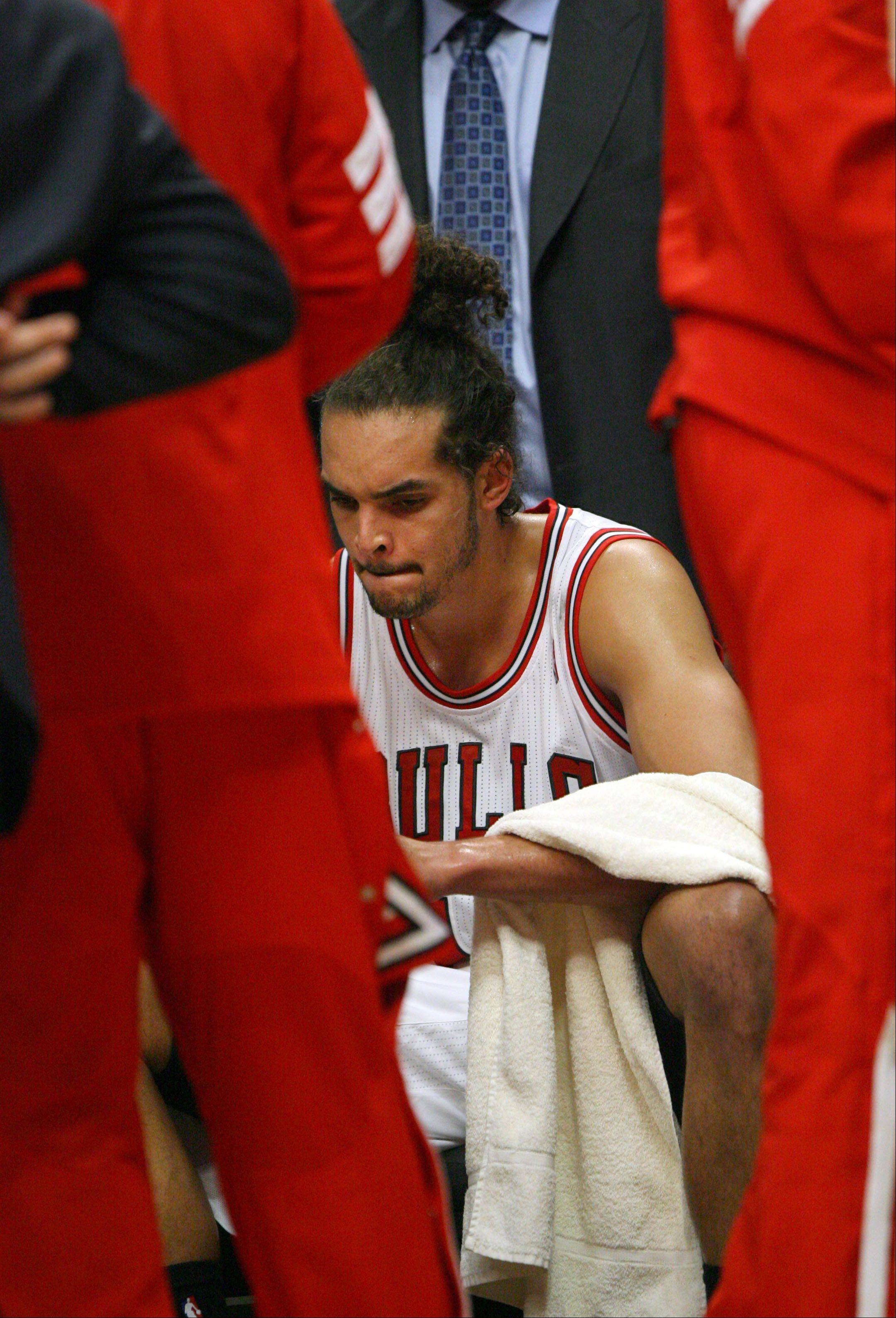 Bulls center Joakim Noah sits dejected on the bench during their 109-92 loss the 76ers during Game 2 at the United Center.