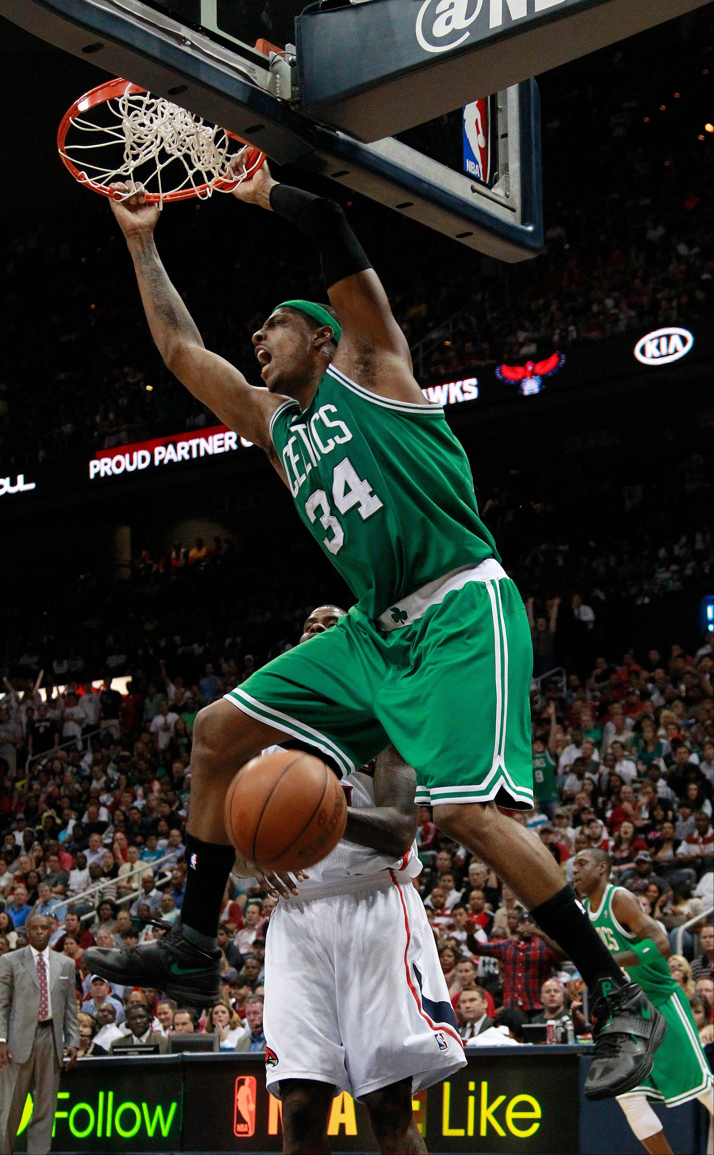 Boston Celtics forward Paul Pierce scores Tuesday in the second half of Game 2 against the Atlanta Hawks in Atlanta. Boston won 87-80 and evened the series at one game each.