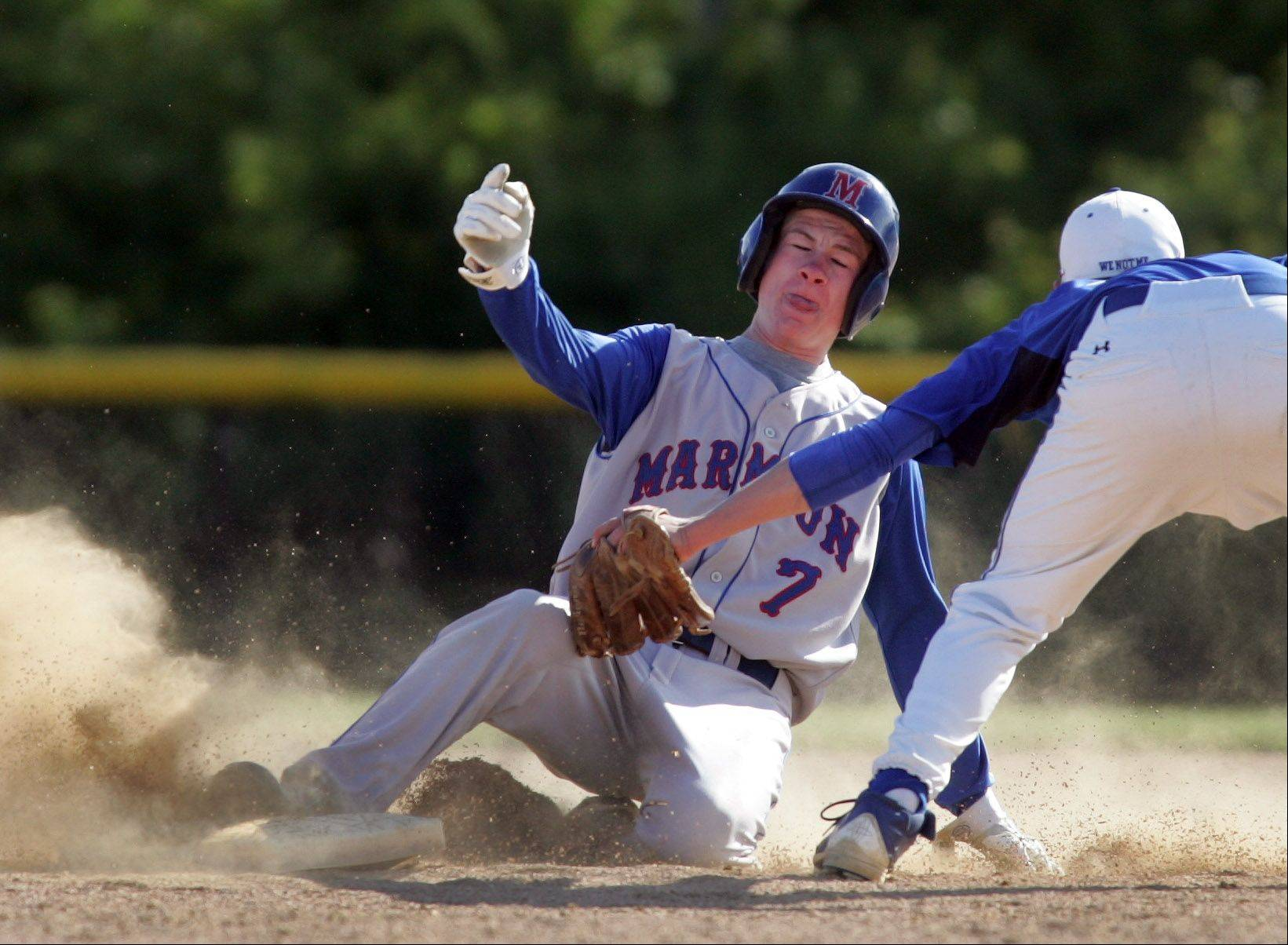 Mitch Sterne of Marmion Academy beats the tag of David Fisher, right, of St. Francis, as he slides into second base during baseball in Aurora on Monday.