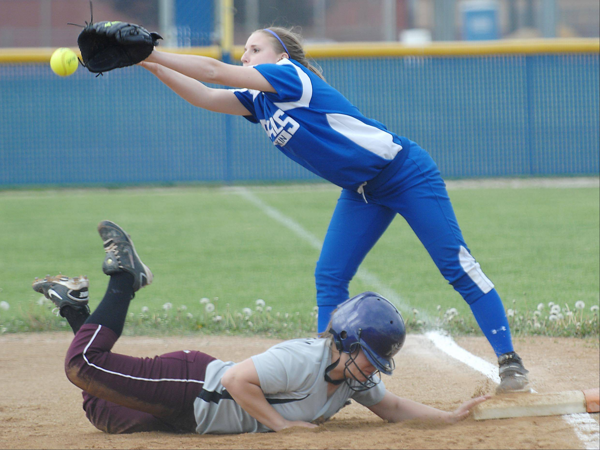 Elgin's Anna Eckholm gets safely back to first base as Larkin's Rebekah Harrington covers the bag Wednesday.