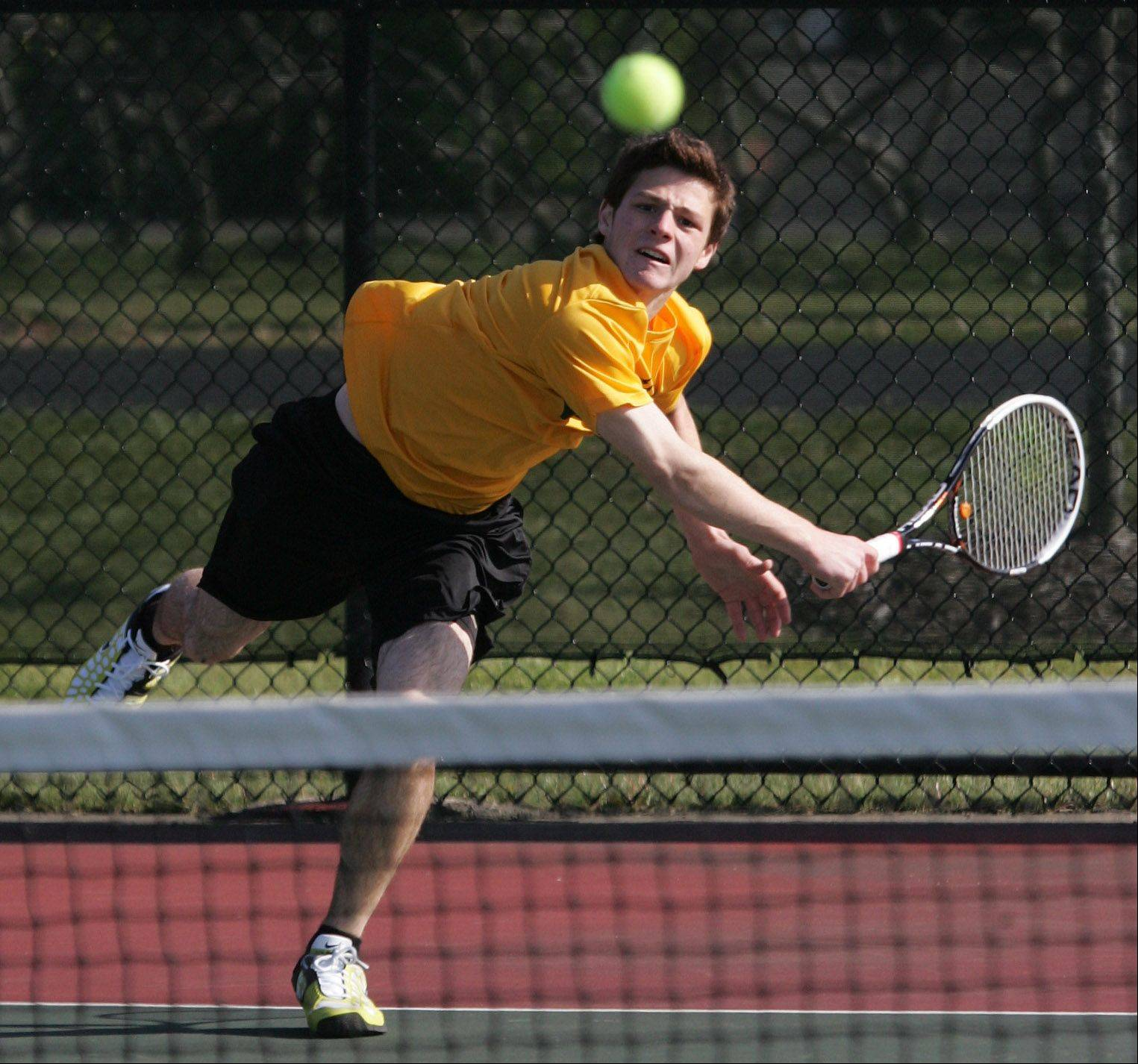 Stevenson's Jeremy Bush battles Lake Forest's Scott Christian Thursday's tennis meet at the Vernon Hills Athletic Complex.