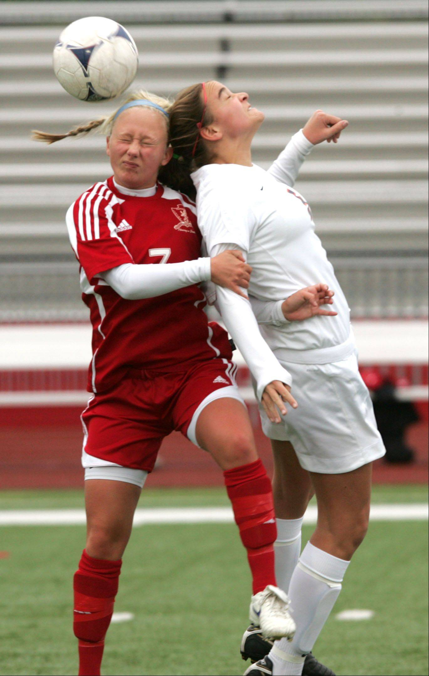 Naperville Central's Carly Franzese, left, battles Naperville North's Abbie Boswell, right, during the 2012 Girls Soccer Naperville Invitational.