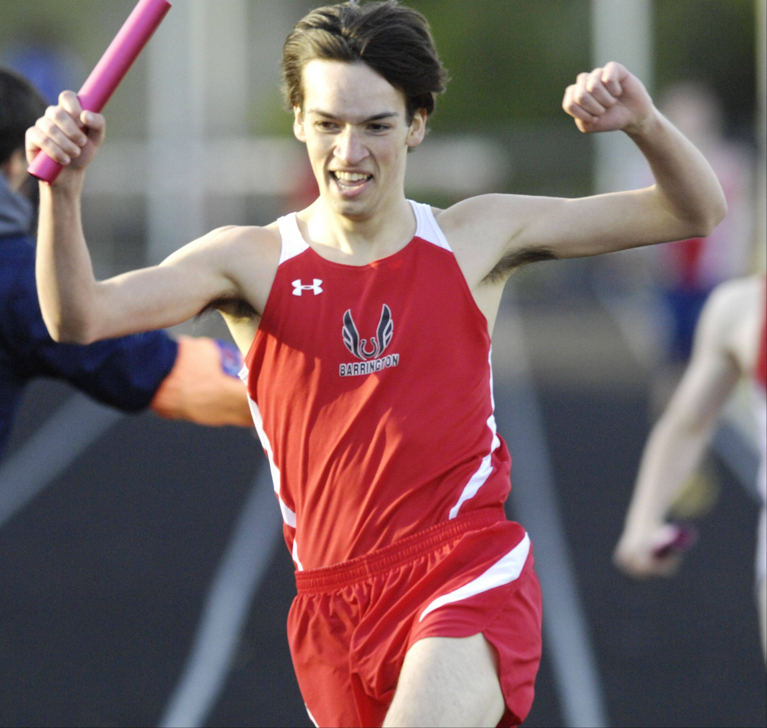 Barrington's Phil Quarfoot celebrates after his team came from behind to win a relay event during Tuesday's Mid-Suburban League boys track meet at Schaumburg.