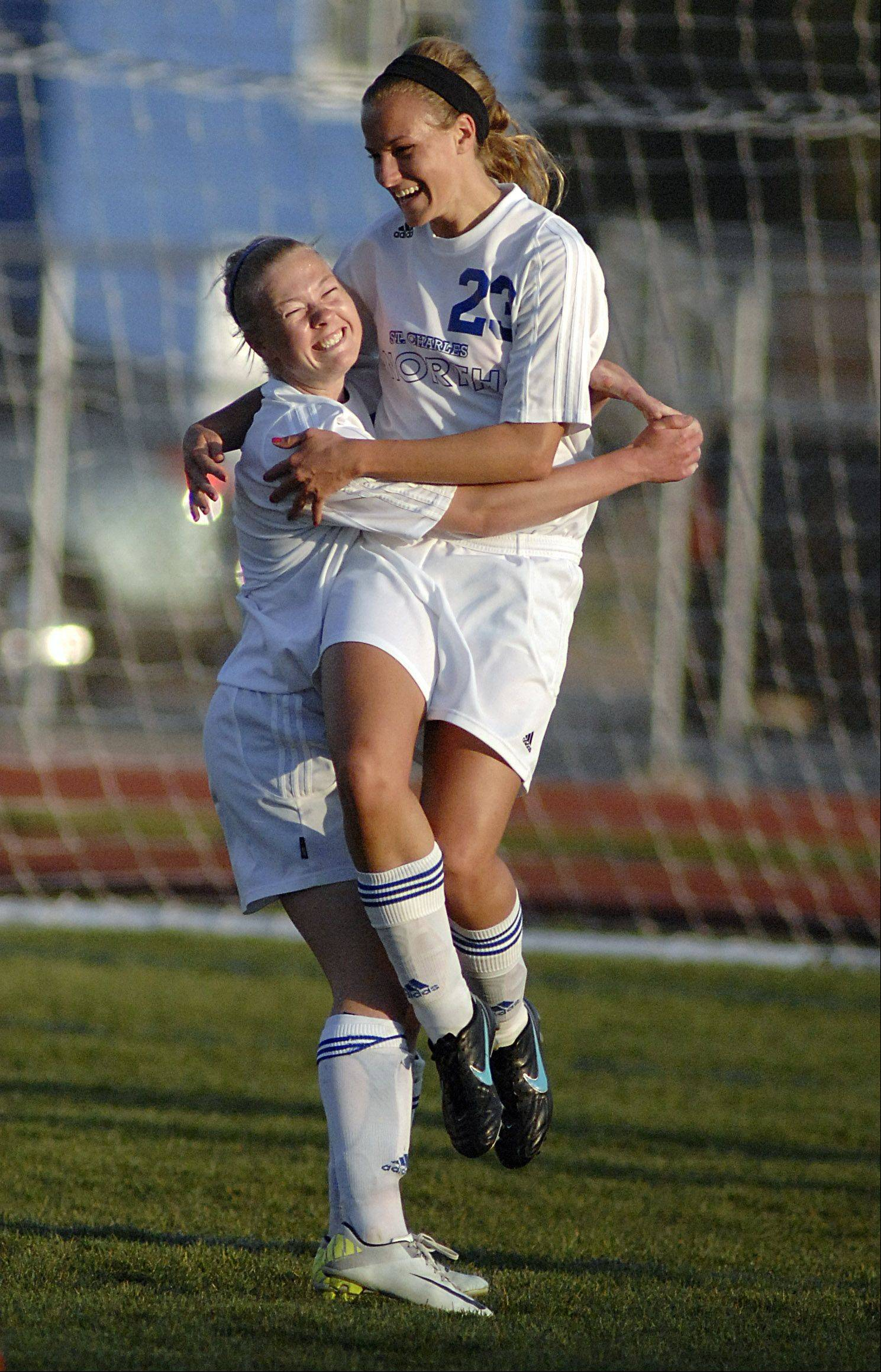 St. Charles North's Lauren Koehl celebrates with teammate Natalie Winkates after scoring a goal for the North Stars in the first half on Tuesday.