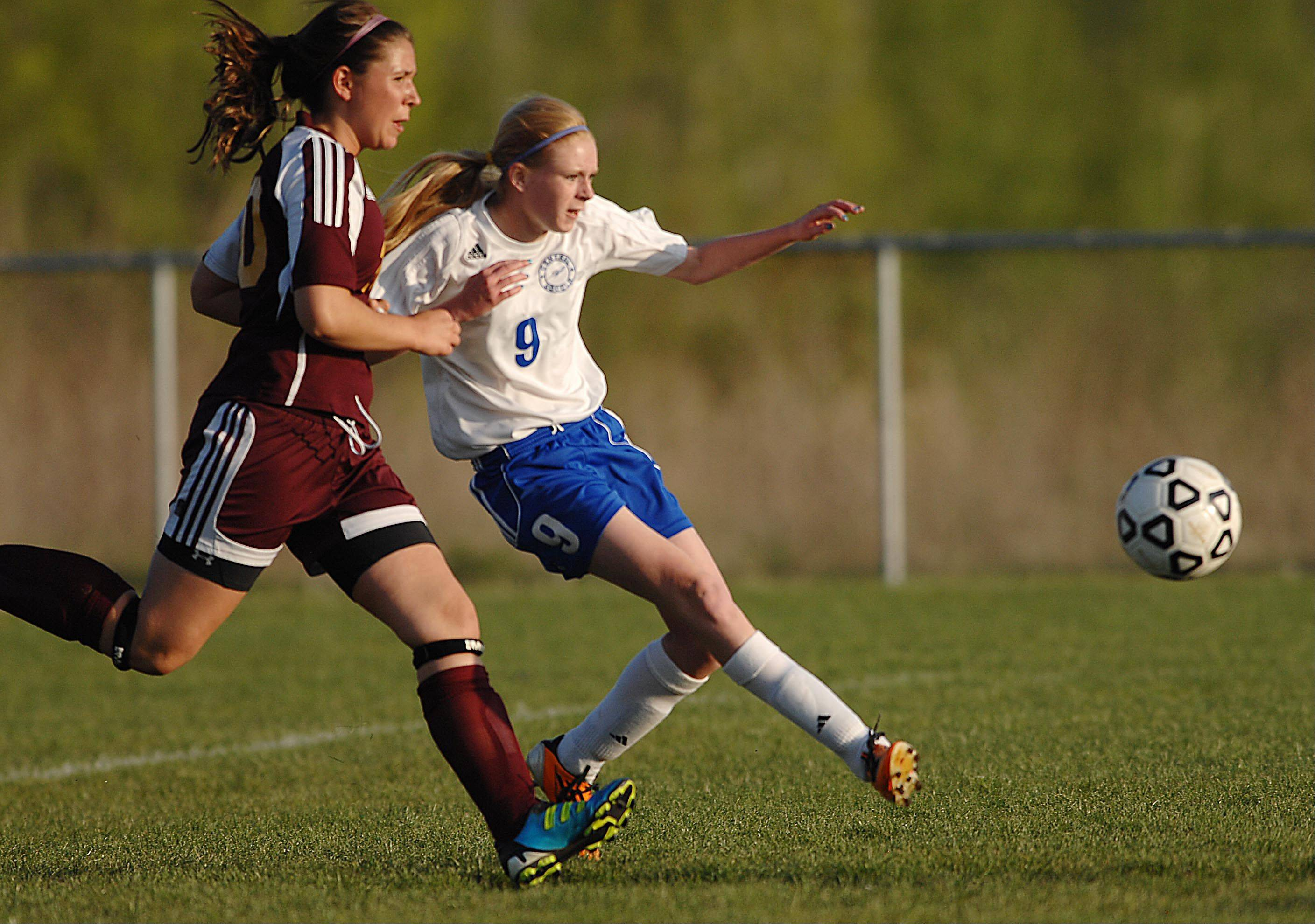 Burlington Central's Courtney Andrew takes a shot as Richmond-Burton's Cassie Owen trails Tuesday in Burlington.