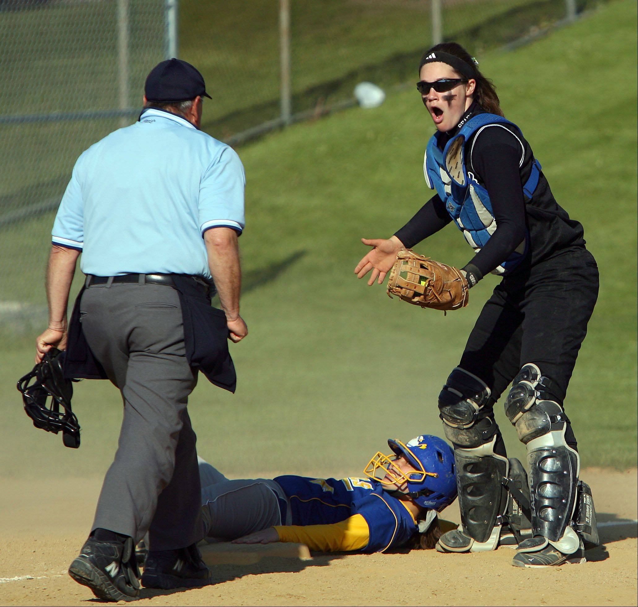 Lake Zurich's Christina Sandstedt, right, argues the call after Warren's Hayley Roane is called safe at third during their game Tuesday at Lake Zurich High School.