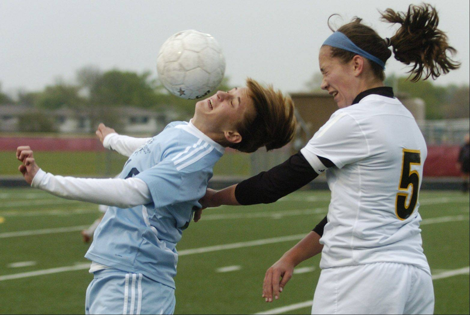 Prospect's Emily Novak, left, and Schaumburg's Sarah Kozlowski leap for a header during Wednesday's game at Schaumburg.