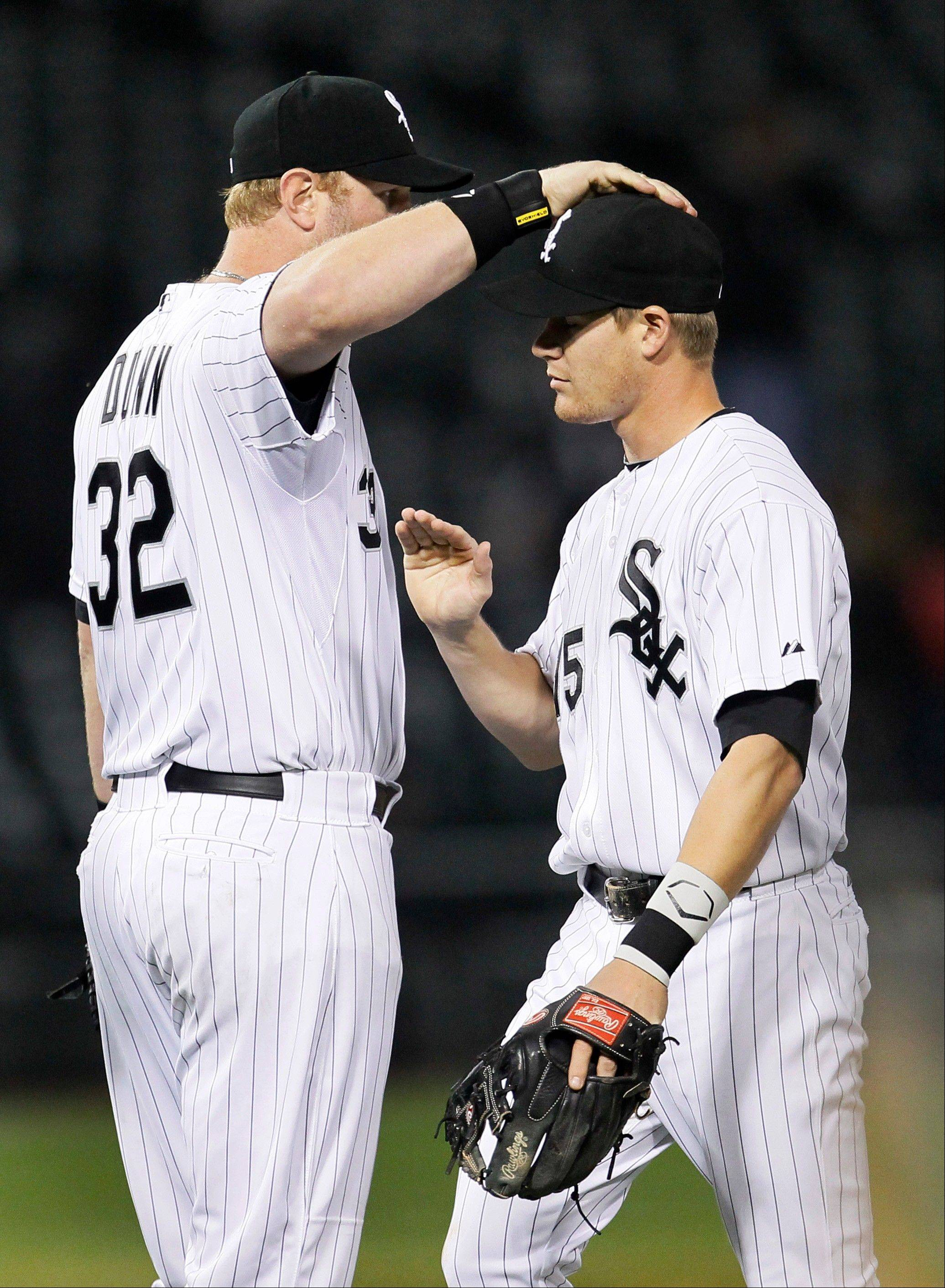 White Sox first baseman Adam Dunn pats second baseman Gordon Beckham on the head after the White Sox 7-2 win over the Cleveland Indians.