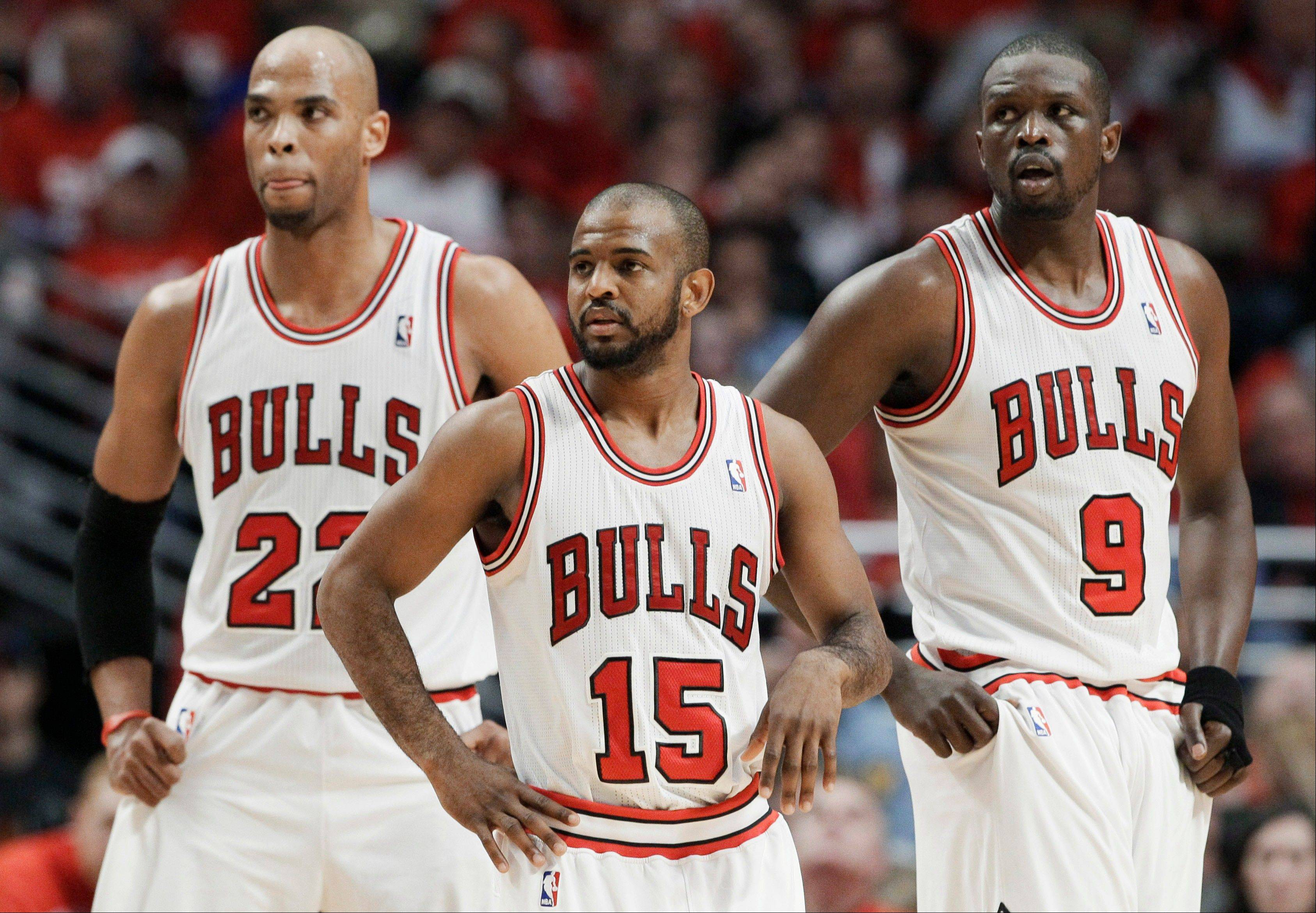 Bulls forward Taj Gibson, guard John Lucas III and forward Luol Deng pause during the third quarter of Game 2 Tuesday against the Philadelphia 76ers in Chicago.