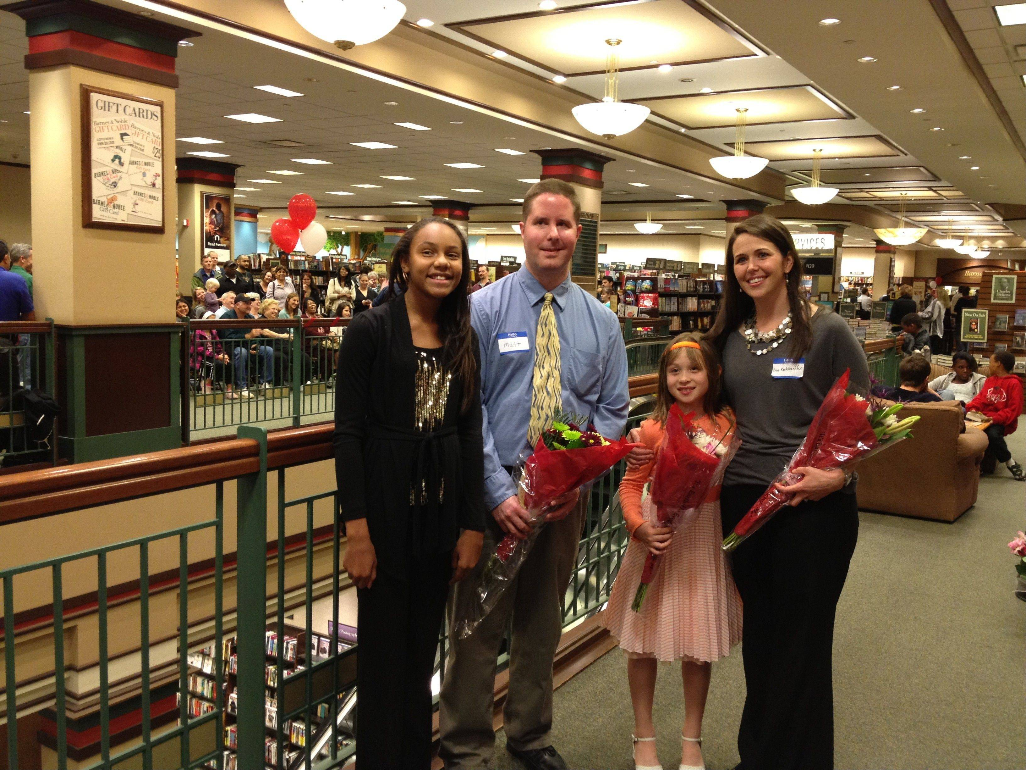"Two local students were named winners in Barnes & Noble's ""My Favorite Teacher"" program. From left, are Joi Freeman, a seventh-grader at Woodland Middle School; her teacher, Matthew Lakemacher; Dakota Lyons, a second-grader at Butterfield School; her teacher, Errin Koehlhoeffer."