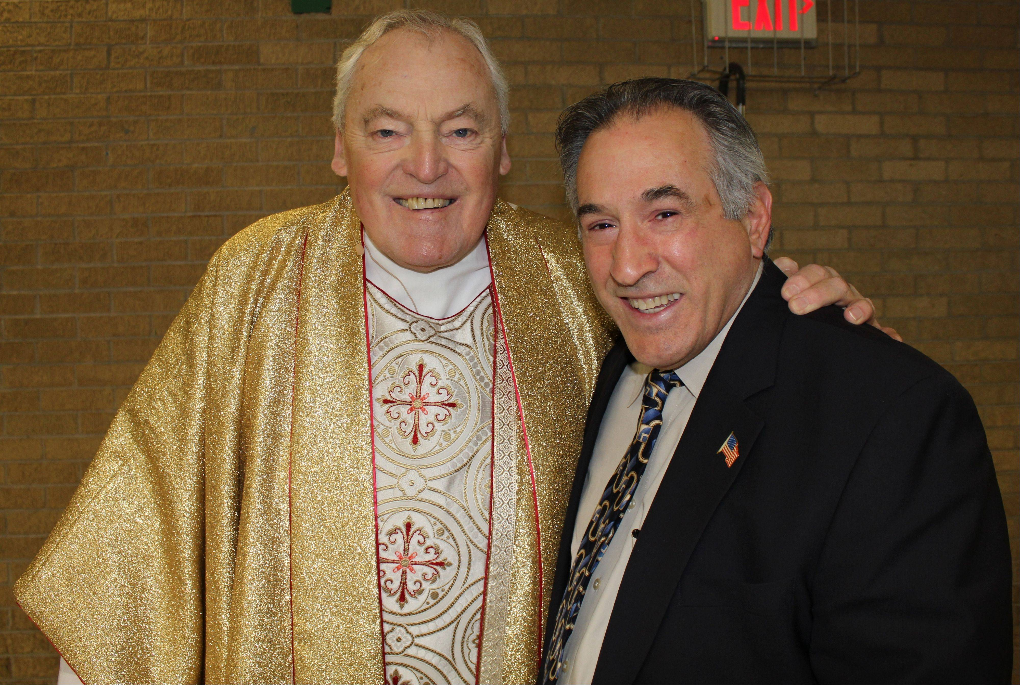 Father John P. Smyth and Des Plaines Mayor Martin J. Moylan pose for a photograph at the Jubilee event at Notre Dame.