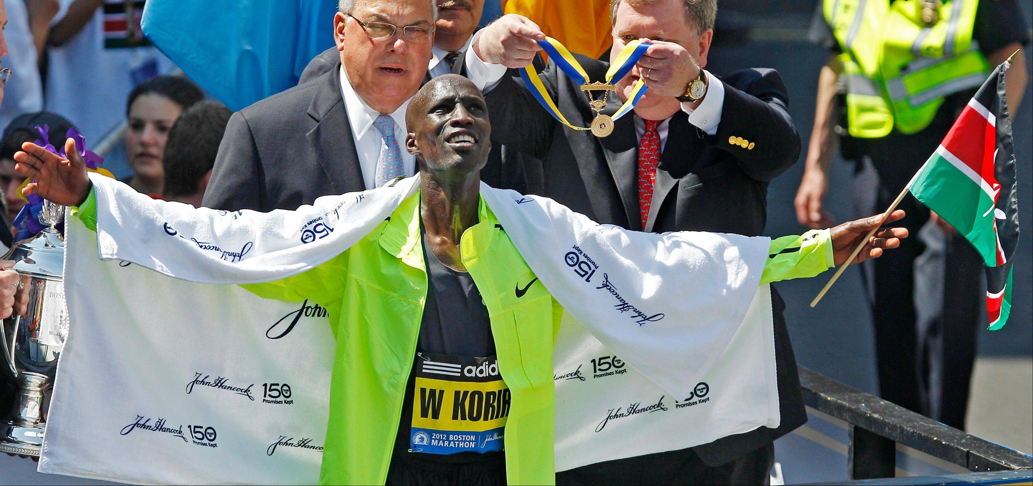 Wesley Korir of Kenya celebrates after winning the 116th Boston Marathon on April 16. He will run the Chicago Marathon this fall for the fifth consecutive year.