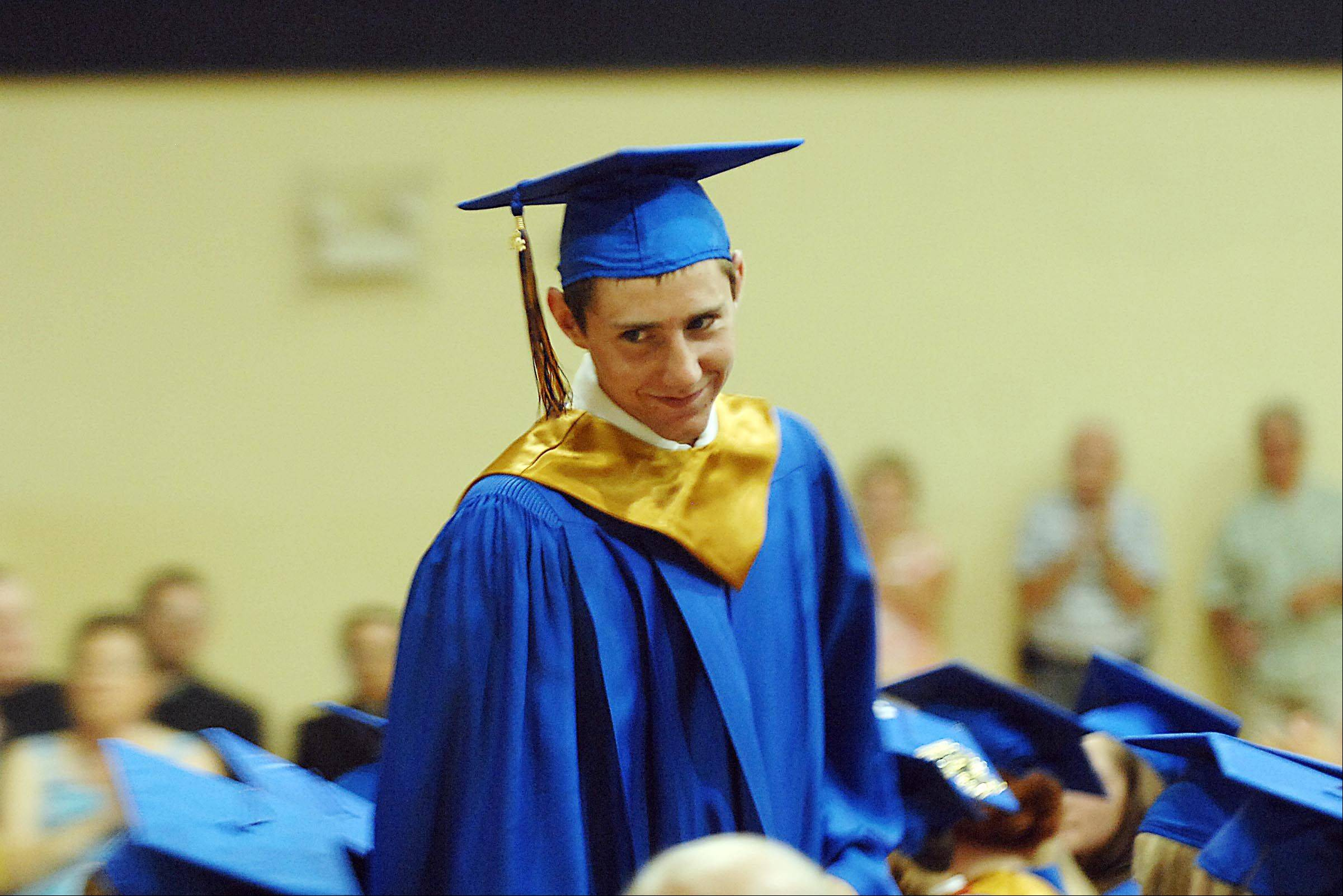 Salutatorian Kevin Bond smiles as he approaches the podium to make his address.