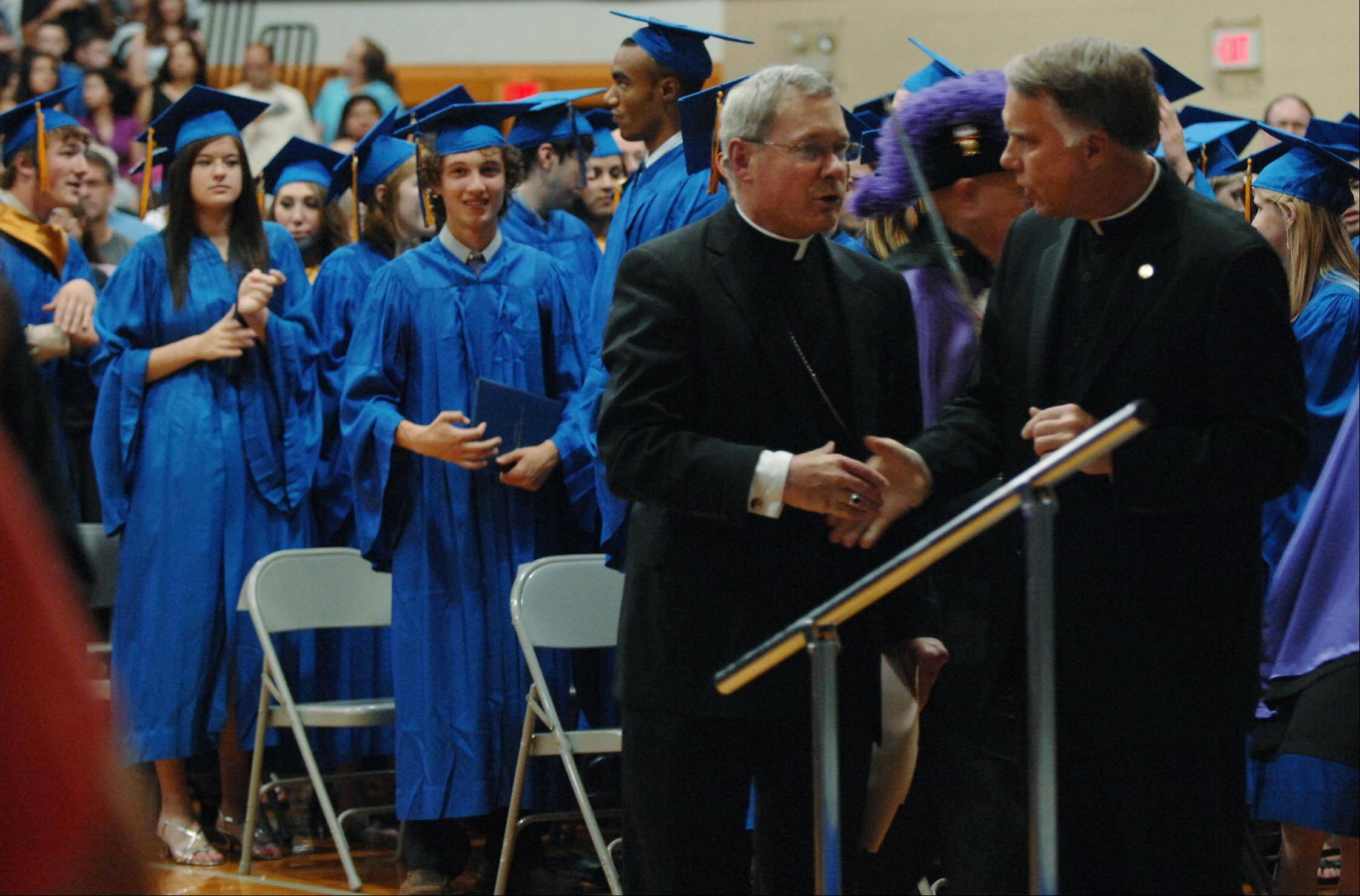 Images from the Aurora Central Catholic High School graduation ceremony Thursday, May 24, 2012 in Aurora.