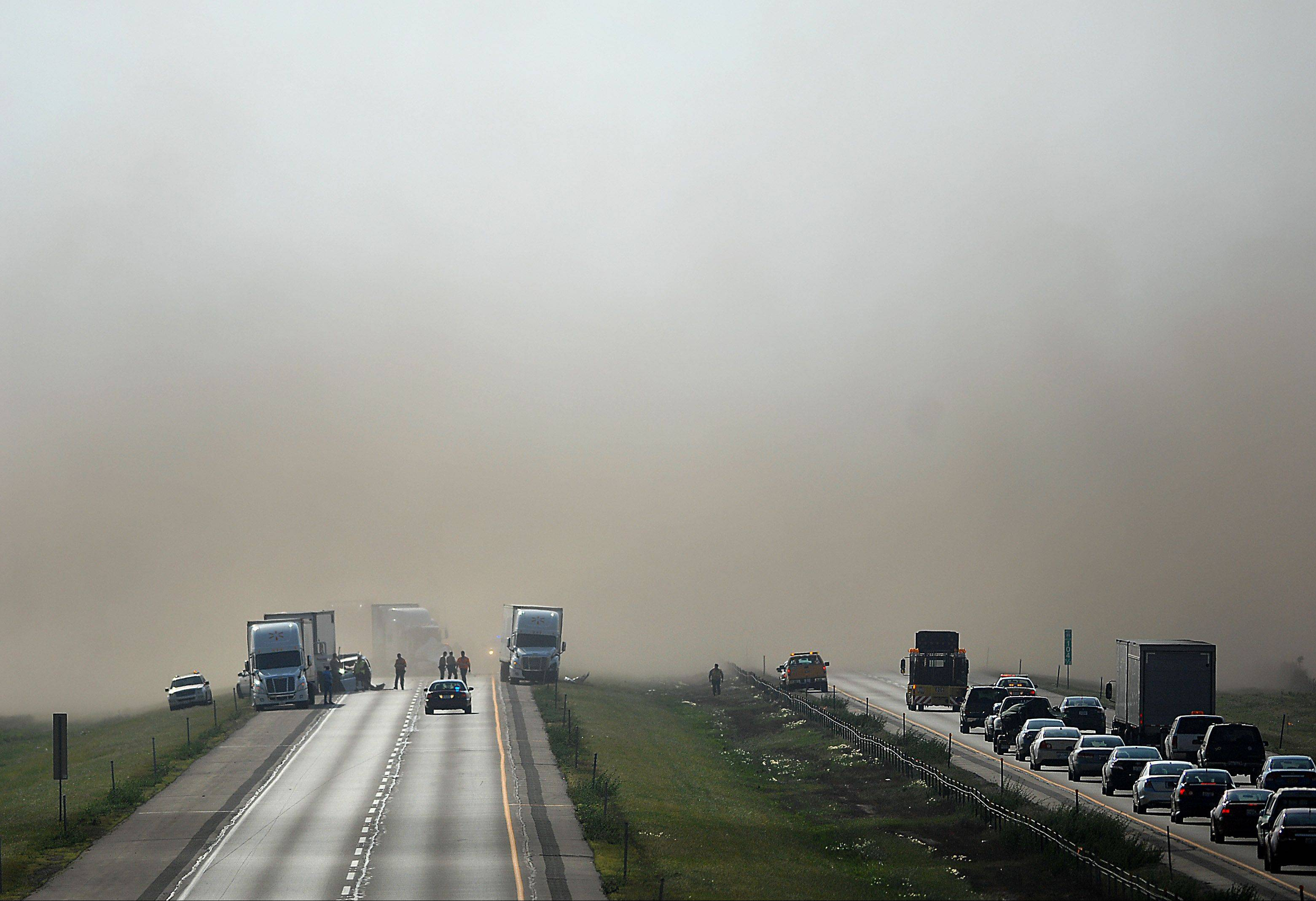 Interstate 88 near Dauberman Road in Kaneville is shut down in both directions just after 4 p.m. as police investigate a multivehicle accident. High winds create a wall of dust.