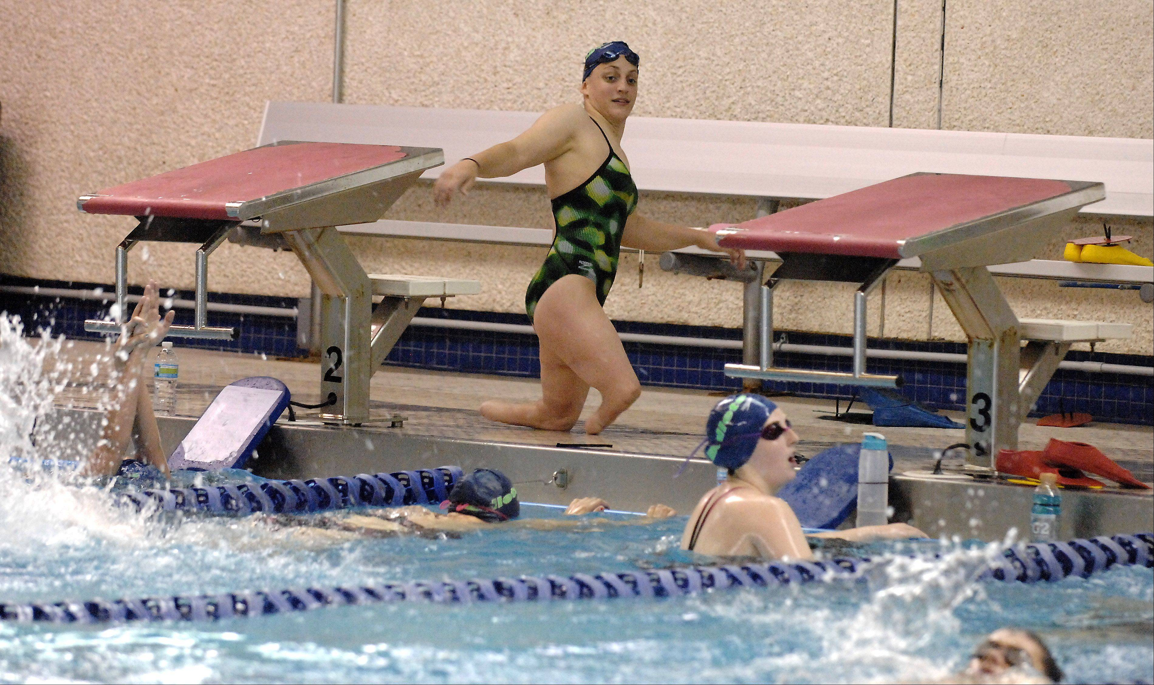 Swimmer Amy Chapman of Batavia walks back to her lane during swim practice in Aurora.