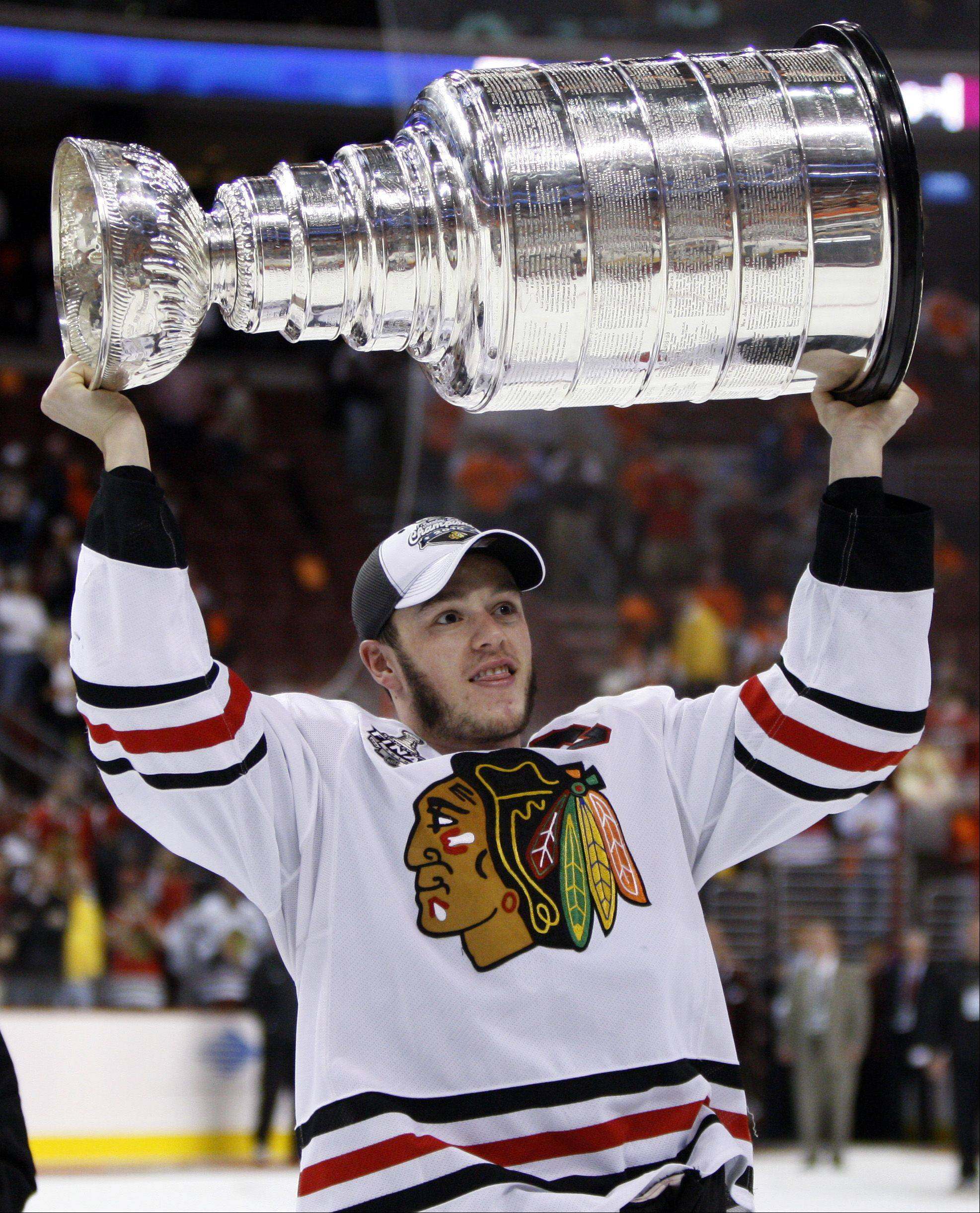 Chicago Blackhawks captain Jonathan Toews lifts the Stanley Cup after the Blackhawks beat the Philadelphia Flyers 4-3 in overtime to win Game 6 of the NHL Stanley Cup hockey finals Wednesday, June 9, 2010, in Philadelphia.