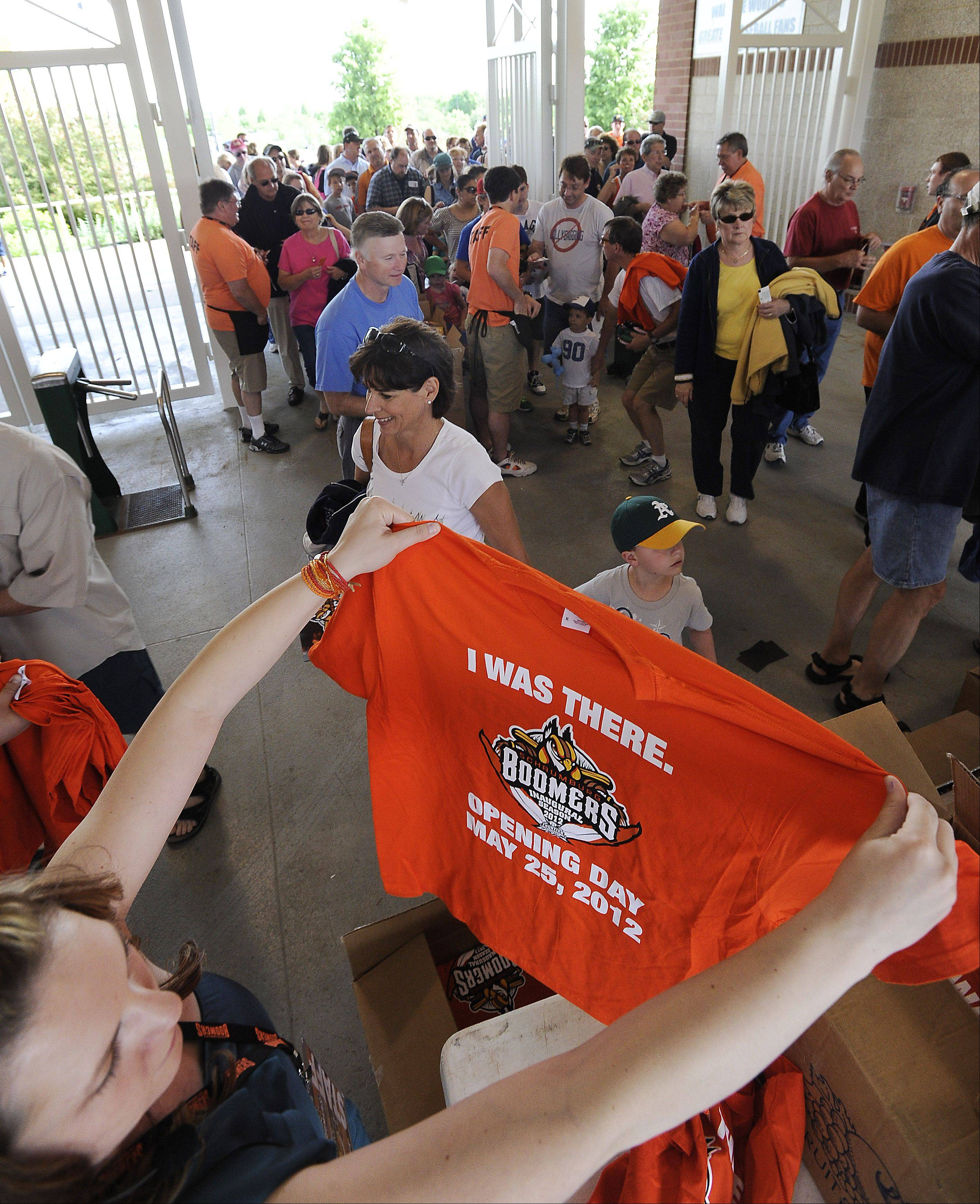 A Schaumburg Boomers fan looks over an opening day shirt that was given out.