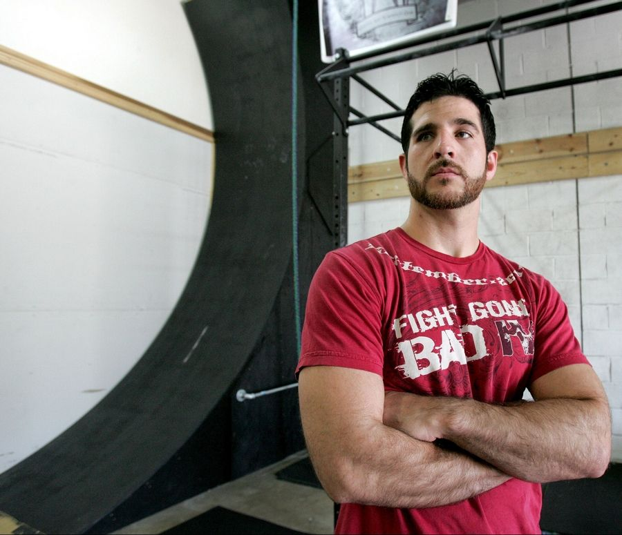 "Nate Aye of St. Charles has replicated some of the obstacles from the TV show ""American Ninja Warrior,"" including the warped wall, in his Lombard gym. He'll be featured on the show this weekend on two different networks."