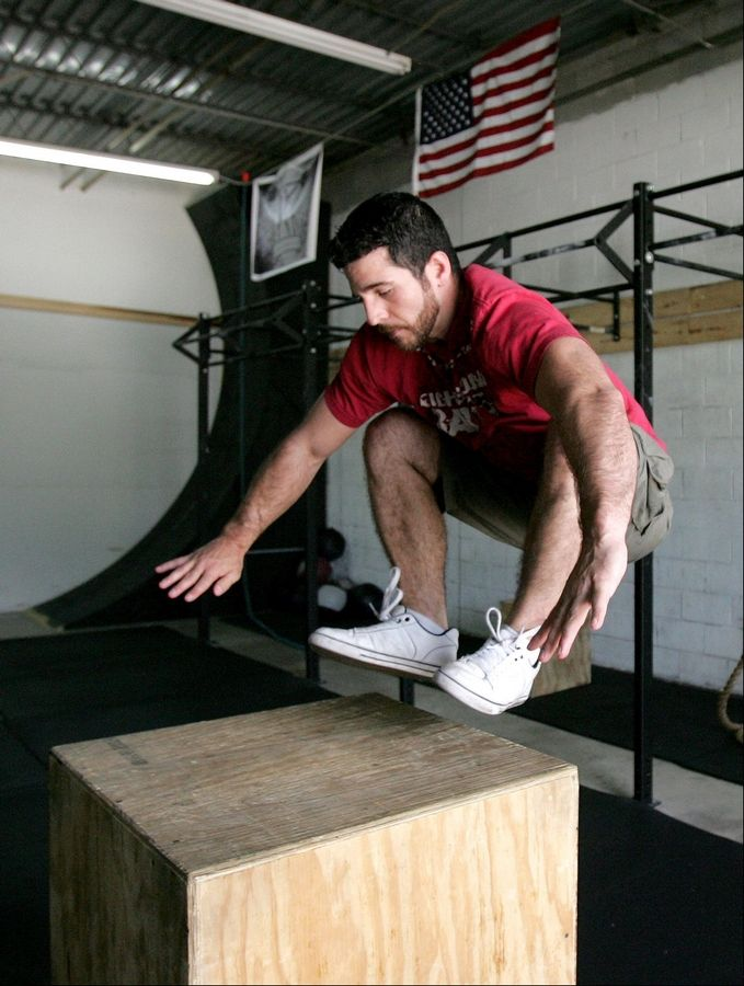 "Nate Aye, owner of Golden Age Strength Club in Lombard, demonstrates how he trained for his appearance on the ""American Ninja Warrior"" TV show."