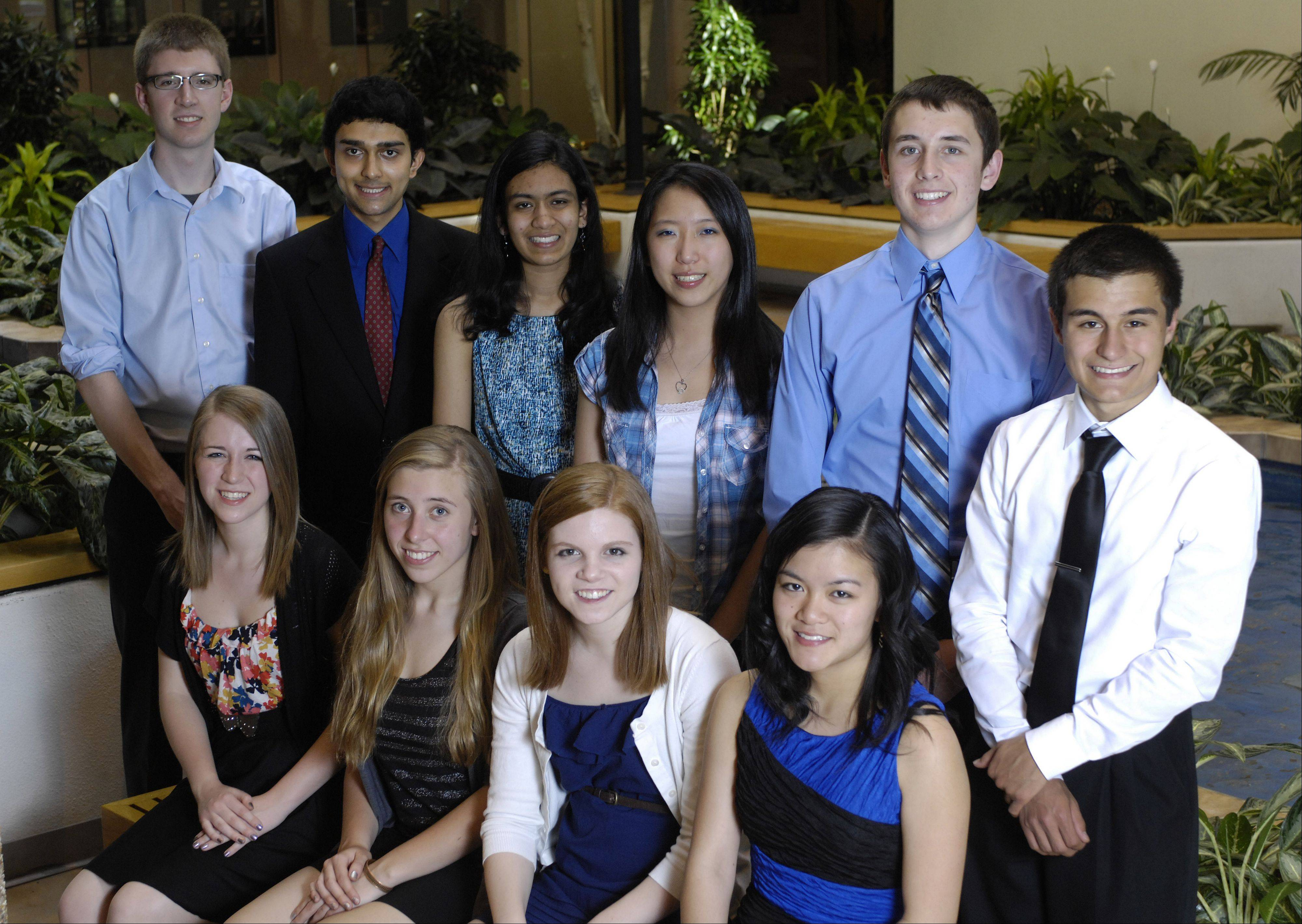 The 2011-12 Northwest Suburban Academic Team, inside the Daily Herald's Arlington Heights office. Front row, from left: Emily Liquin, Palatine High School; Marianne Palczewski, Bartlett High School; Madeline Conway, Prospect High School; Connie Liou, James B. Conant High School. Back row, from left: Alex Linzmeier, Wheeling High School; Anand Patel, James B. Conant High School; Avni Bavishi, Hoffman Estates High School; Mengran Liu, Hoffman Estates High School; Joe Sessions, John Hersey High School and Antonio Spina, Bartlett High School.