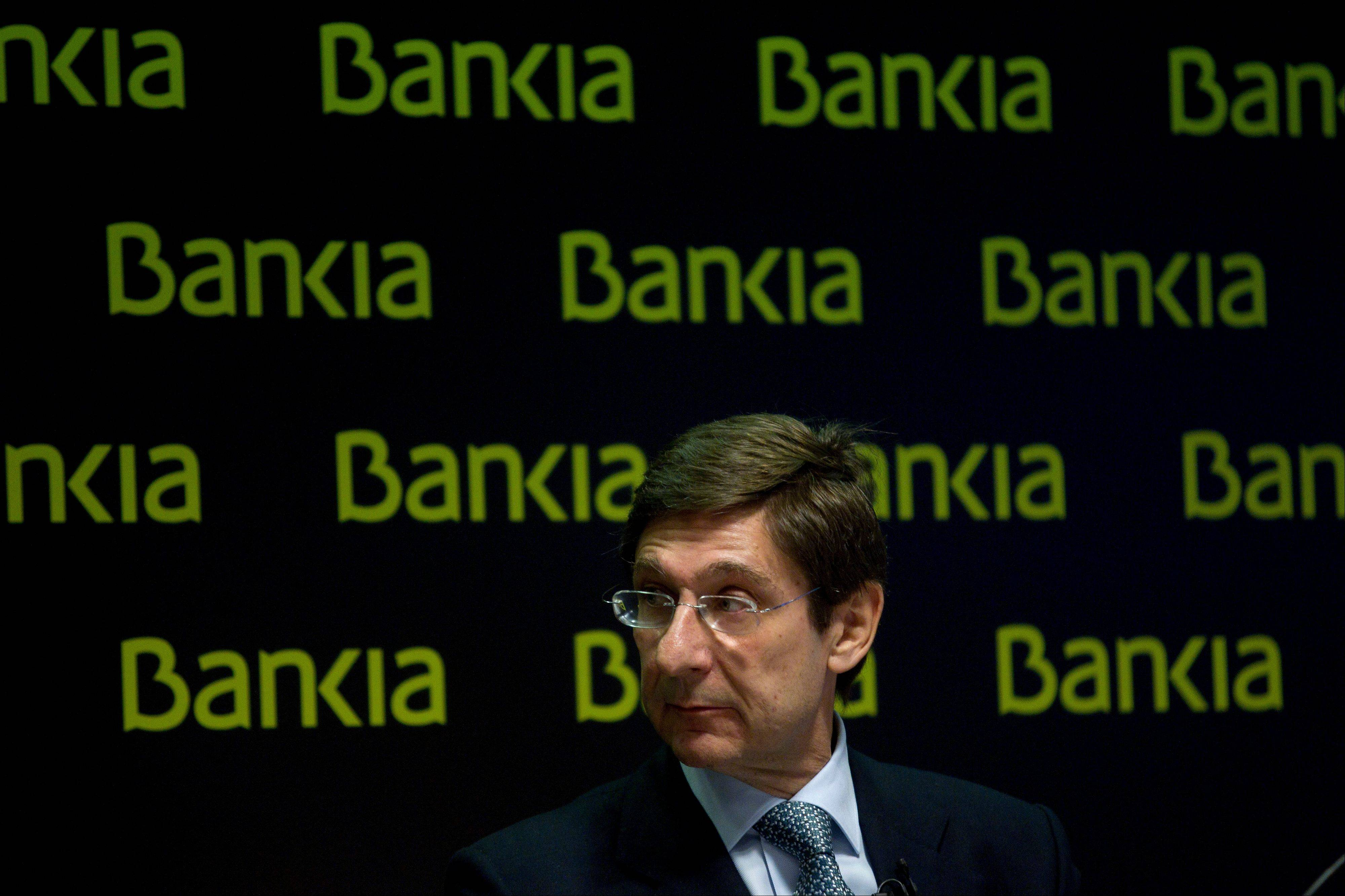 Bankia's president, Jose Ignacio Goirigolzarri, looks to his side during a press conference at the bank's headquarters in Madrid, Saturday. Spain's troubled bank, Bankia, has asked the Spanish government for $23.8 billion in financial support just as a leading credit rating agency downgraded it to junk status. The request came as Standard & Poor's downgraded Bankia and four other Spanish banks to junk status because of uncertainty over restructuring and recapitalization plans.