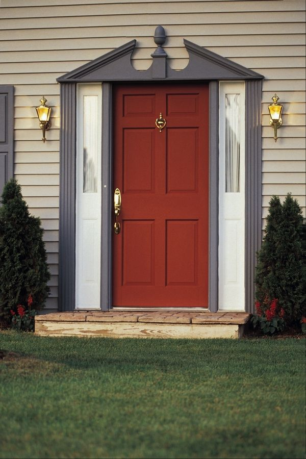 The sidelights and front door are usually installed as one unit, so replacing just the door can be a tricky operation.