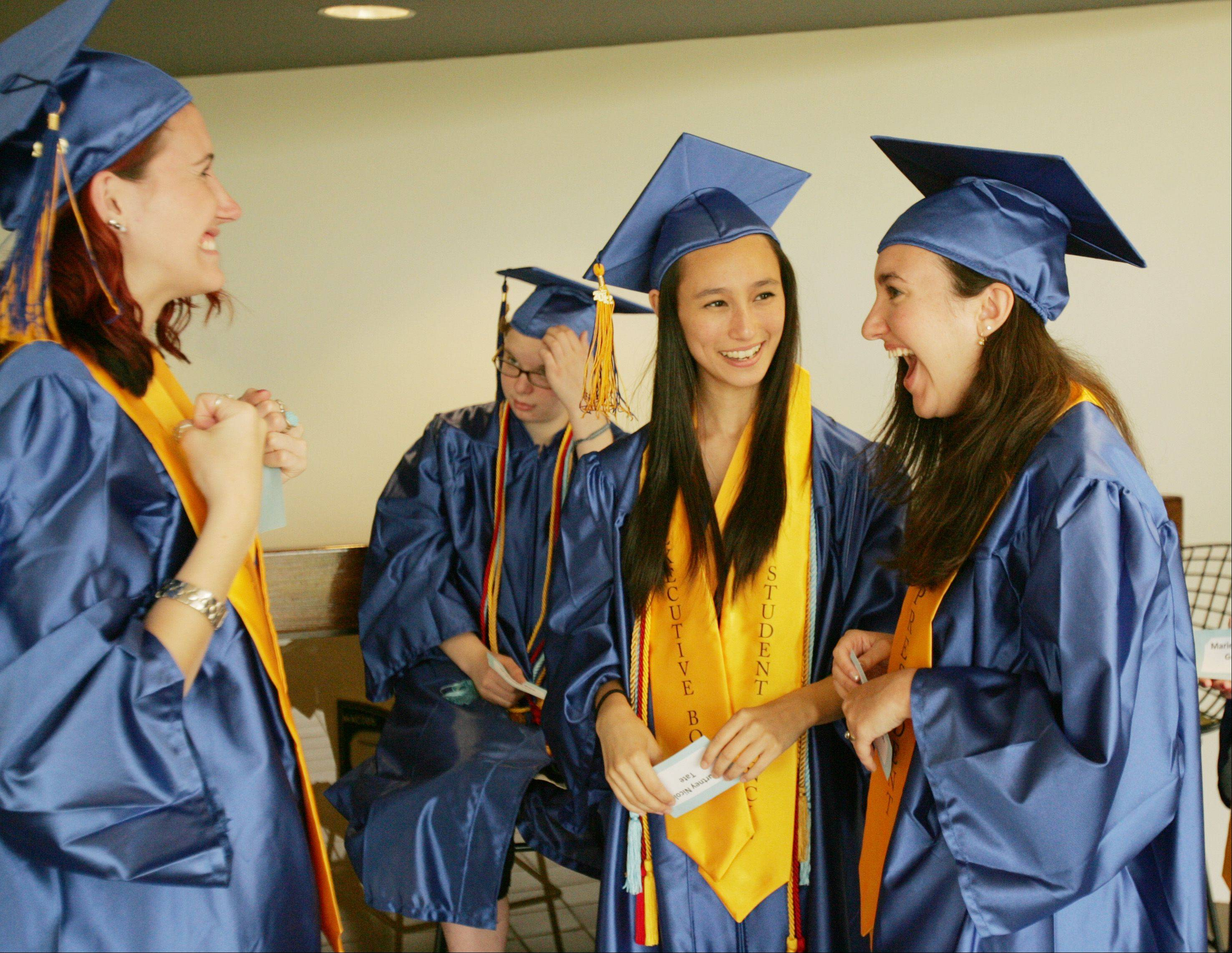 Jonna Sekowski, left, and Courtney Tate, center, along with Senior Class President Allison Schultz, right, talk before their 2012 Wheaton North High School graduation, held at College of DuPage in Glen Ellyn.