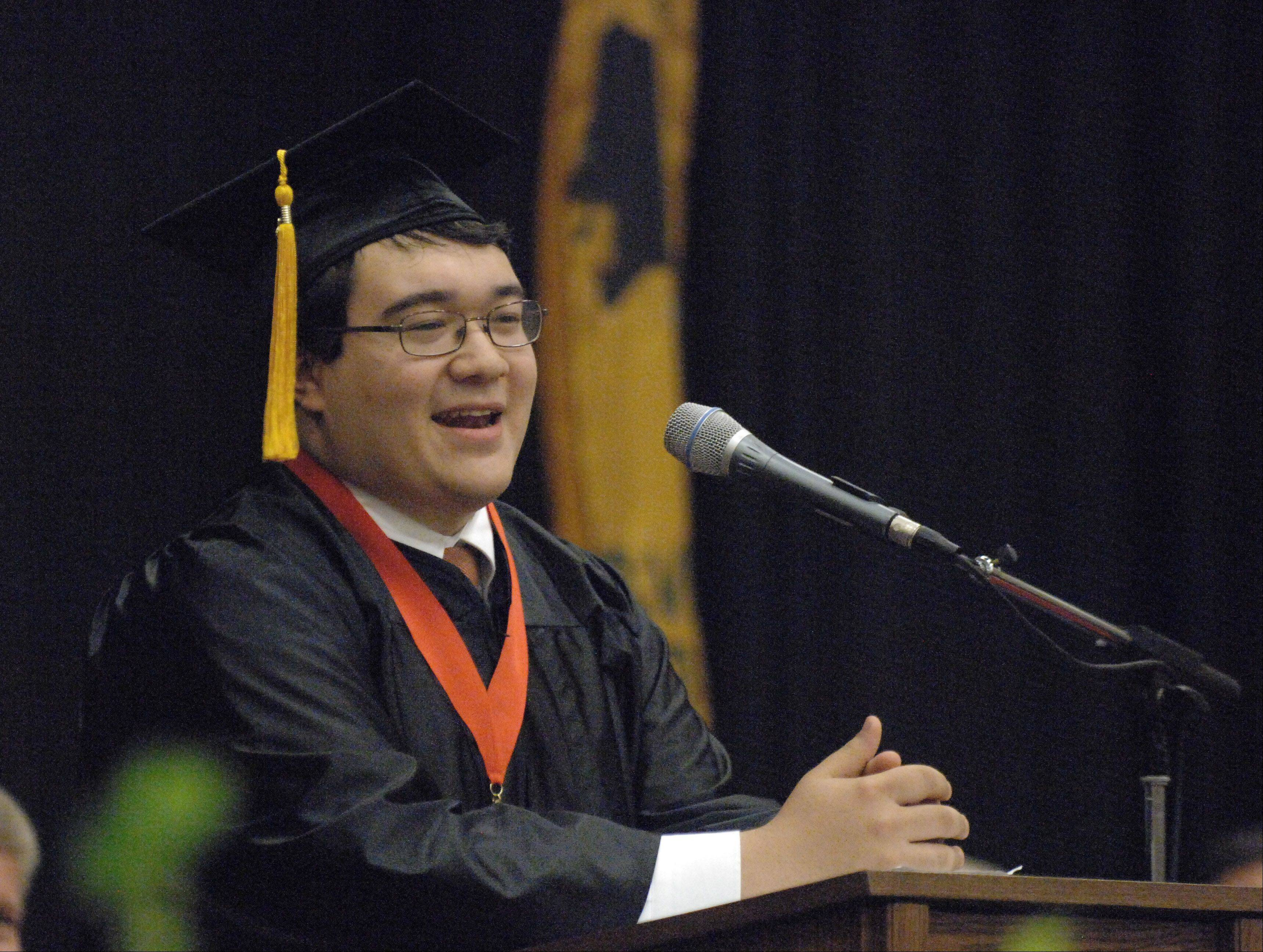 Samuel Niiro gives the commencement address during the Wheaton Warrenville South graduation at college of DuPage Saturday.