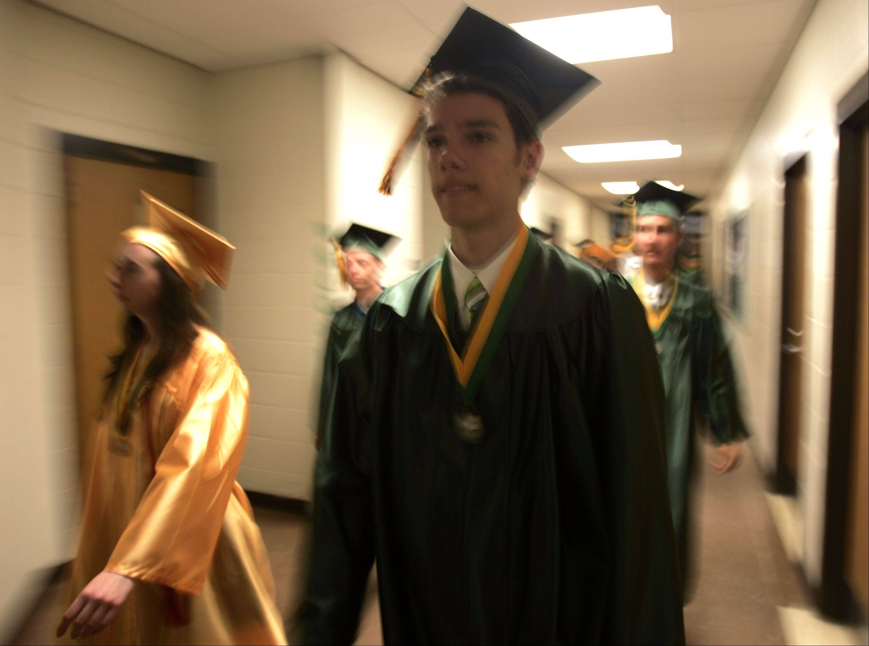 Mark Andruszkiewicz makes his way with his classmates to the Crystal South High School graduation Saturday May 26, 2012.