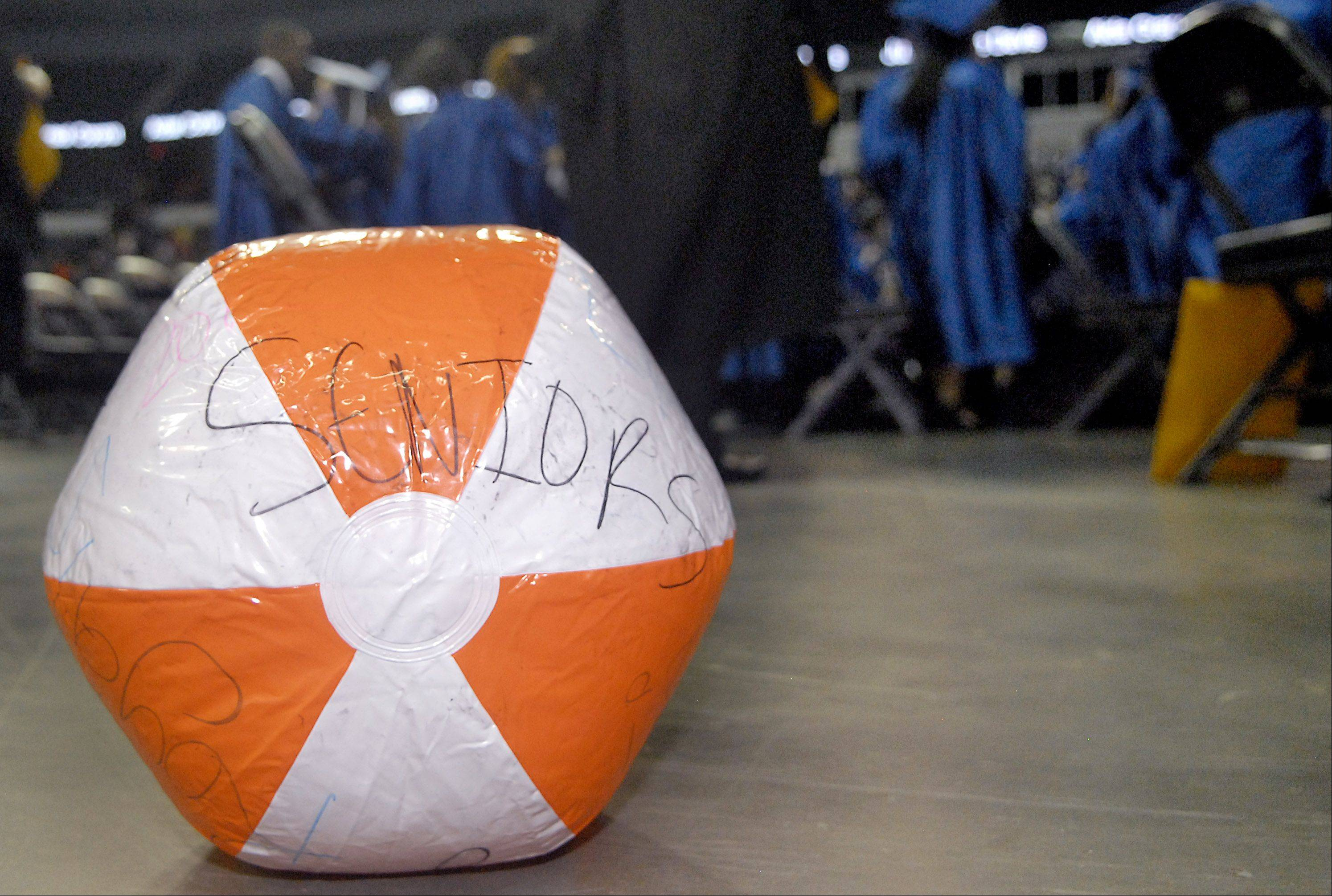 One of several beach balls floats around during the final moments of Larkin High School's commencement ceremony .