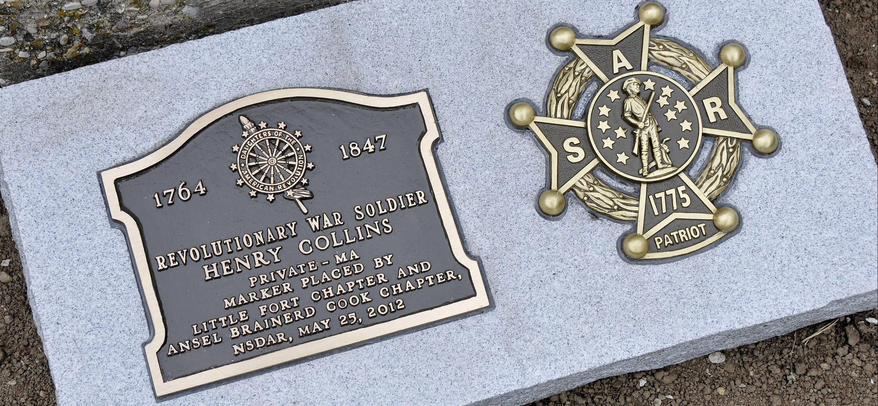 Members of the Daughters of the American Revolution from Libertyville and Waukegan and members of the Sons of the American Revolution from Lisle and Naperville unveiled new markers to honor Revolutionary War Soldier Henry Collins, who is buried in Wadsworth.