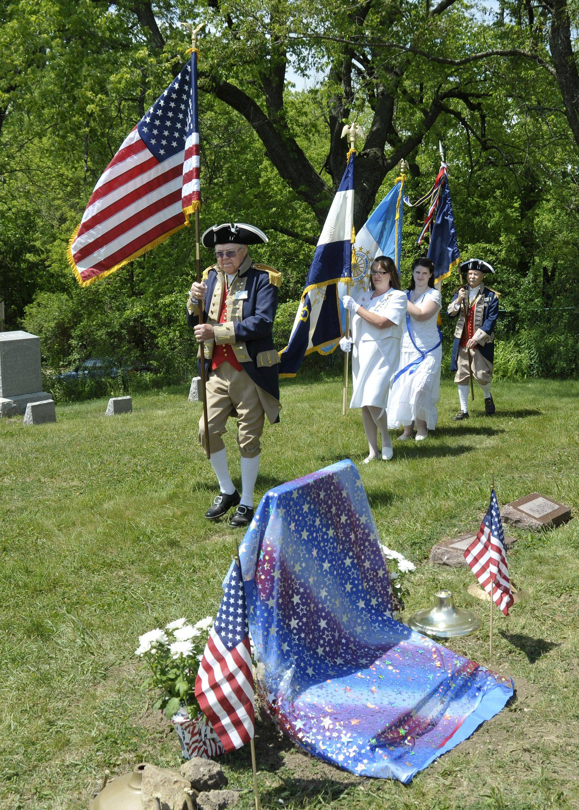 Rod Herbig from Lisle, Racheal Hughes from Zion, Amanda Burja from Long Grove and Don Parrish from Naperville bring the American, Daughters of the American Revolution and Sons of the American Revolution flags into the Mount Rest Cemetery in Wadsworth to begin the ceremony. Members of the Daughters of the American Revolution from Libertyville and Waukegan, and members of the Sons of the American Revolution from Lisle and Naperville honored Revolutionary War soldier Henry Collins Friday at his gravesite in Wadsworth.