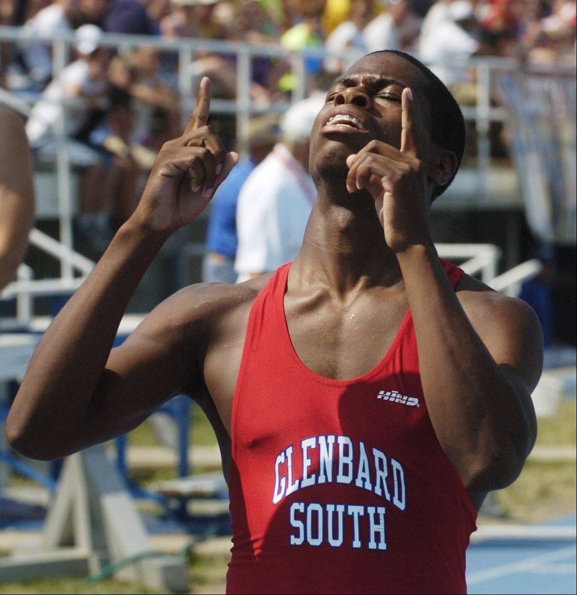 Glenbard South's Elven Walker reacts to his finish in the class 2A 300-meter intermediate hurdles during the IHSA boys state track finals in Charleston Saturday.