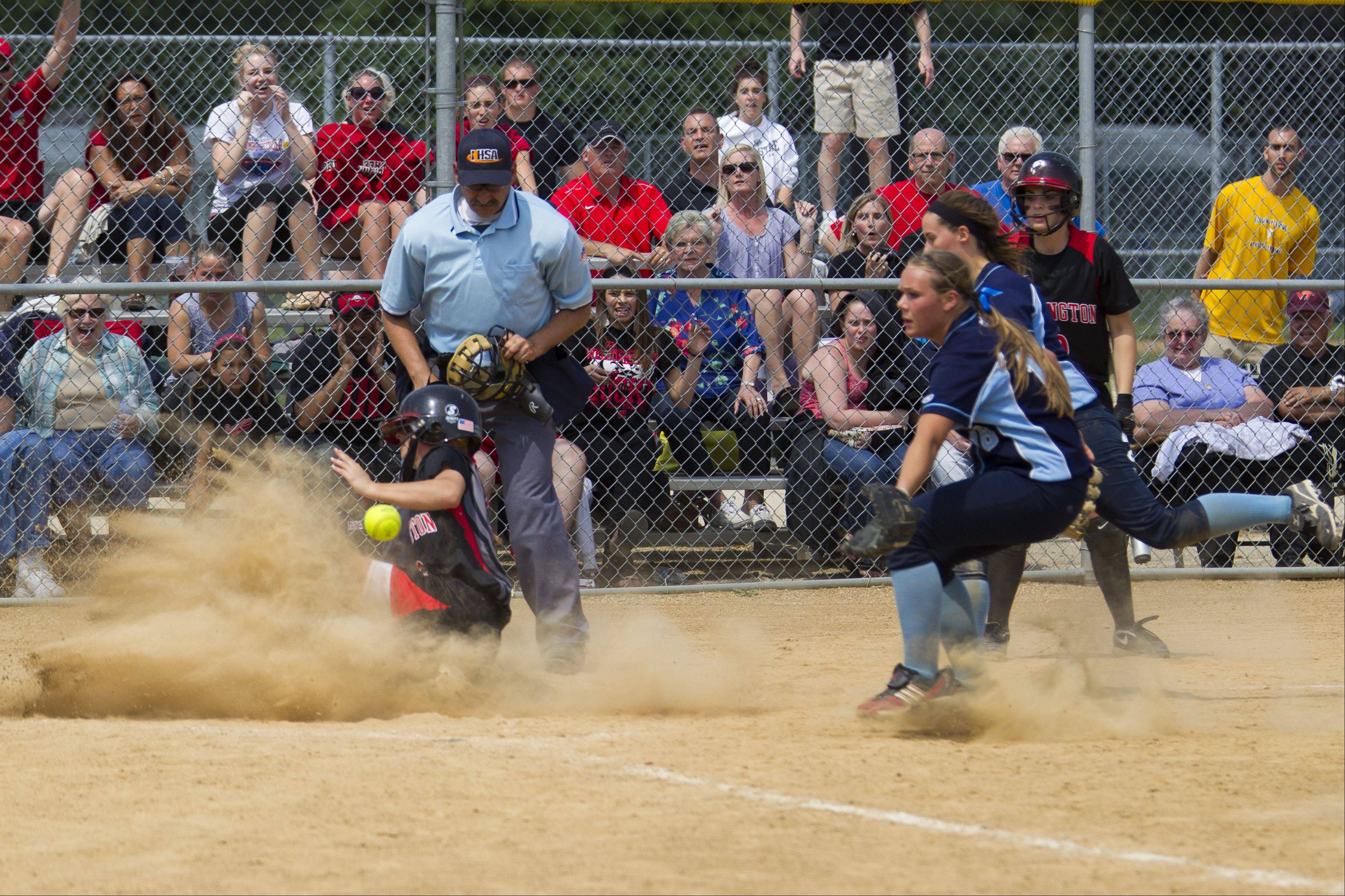 Barrington's Loren Krzysko scores the winning running against Prospect on a wild pitch in the eighth inning Saturday.