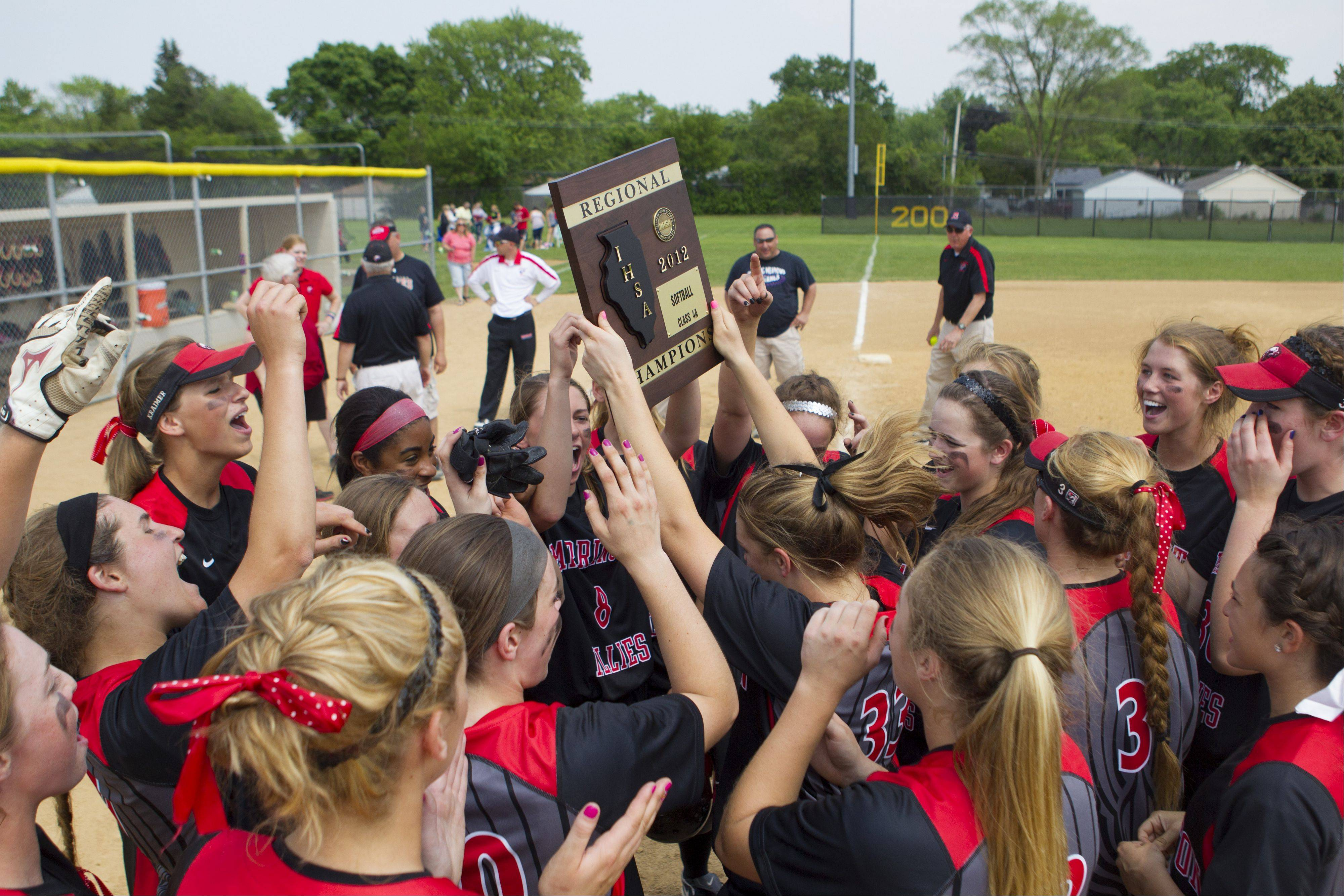 Barrington girls softball team celebrates with its regional plaque Saturday at Prospect.