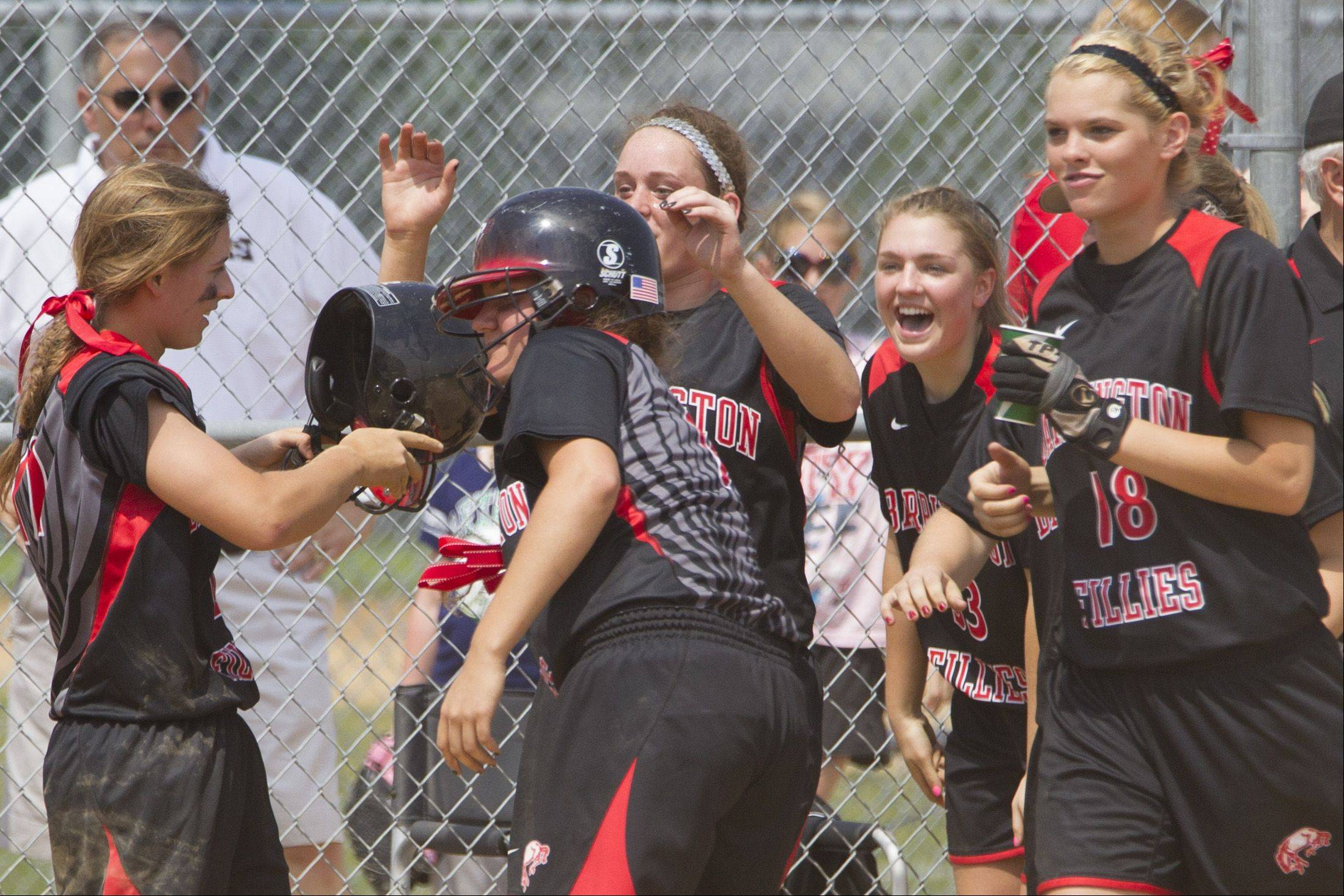 Barrington's Loren Krzysko is greeted by her teammates after she scored the winning run on a wild pitch against Prospect.