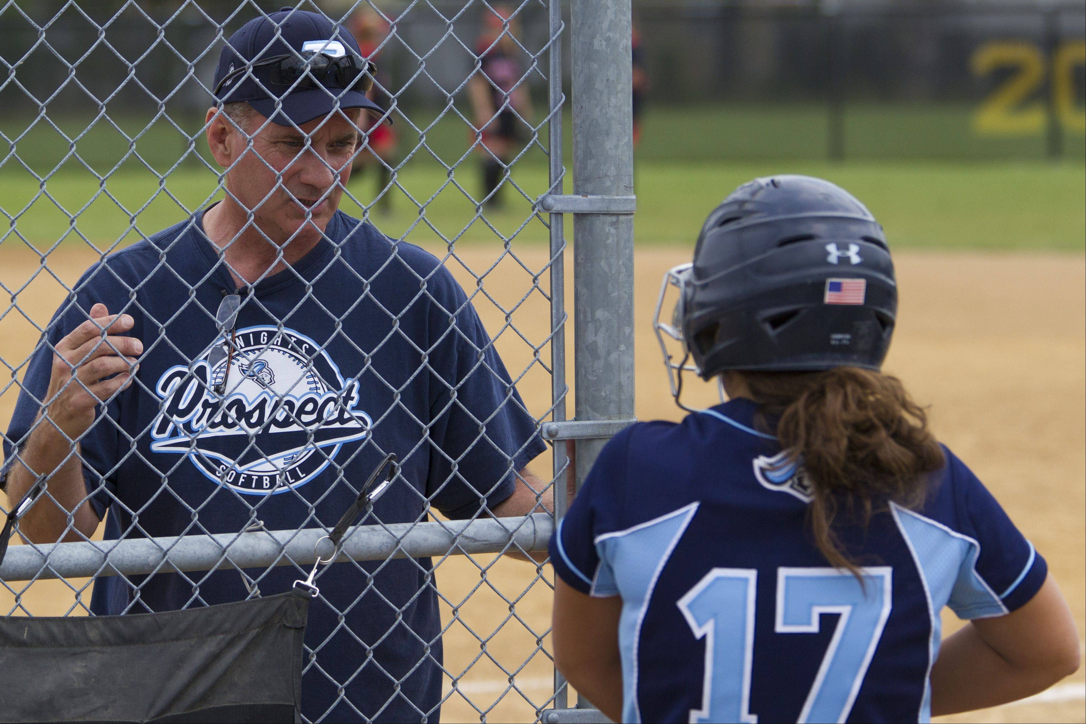 Prospect coach Jim Adair talks with Knights catcher Cassie Poulos during Class 4A regional championship play Saturday.
