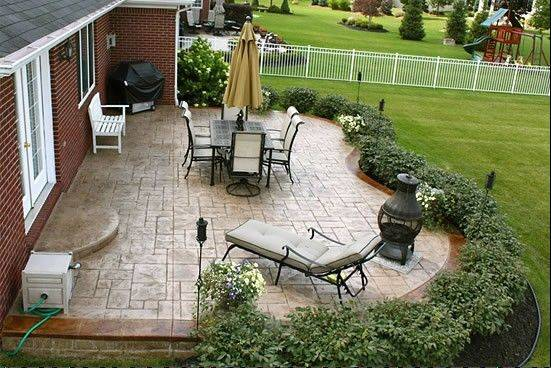 A free-form patio with a dining set large enough for the family would facilitate entertaining.