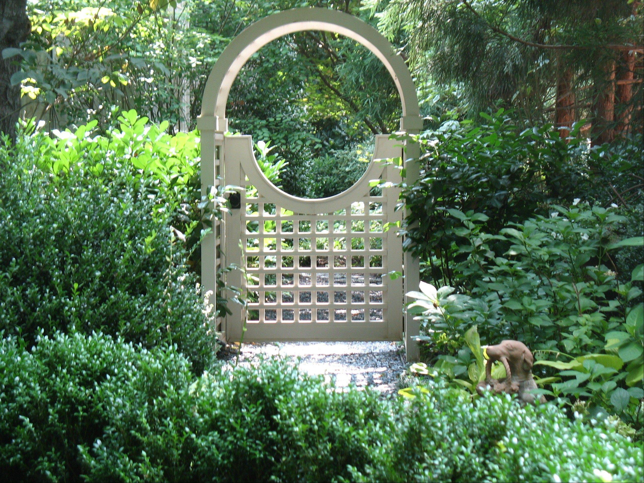 A gated arbor could bridge two areas of the backyard.